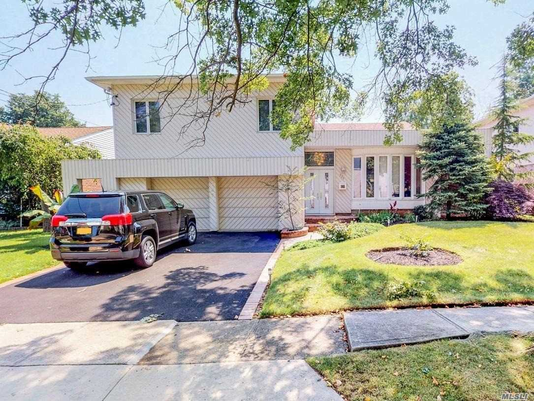 Located On A Tree Lined, Picturesque Street, This Mid Block Split Level Home Is In Well Maintained And Updated Condition Incl Hardwood Flooring. Entry Foyer Leads To Living Room W/Cathedral Ceiling, Dr, Eik W/Ss Appliances & Skylight . Steps Down To Den With Fireplace, Laundry Rm, Garage Access & Sliders Leading To Paver Patio & Fenced Backyard. Steps Up To Master Ensuite W Private Bath, Walk In Closet & Easy Attic Access W Tons Of Storage Space. 3 Additional Bedrooms & Full Bath On Same Level.