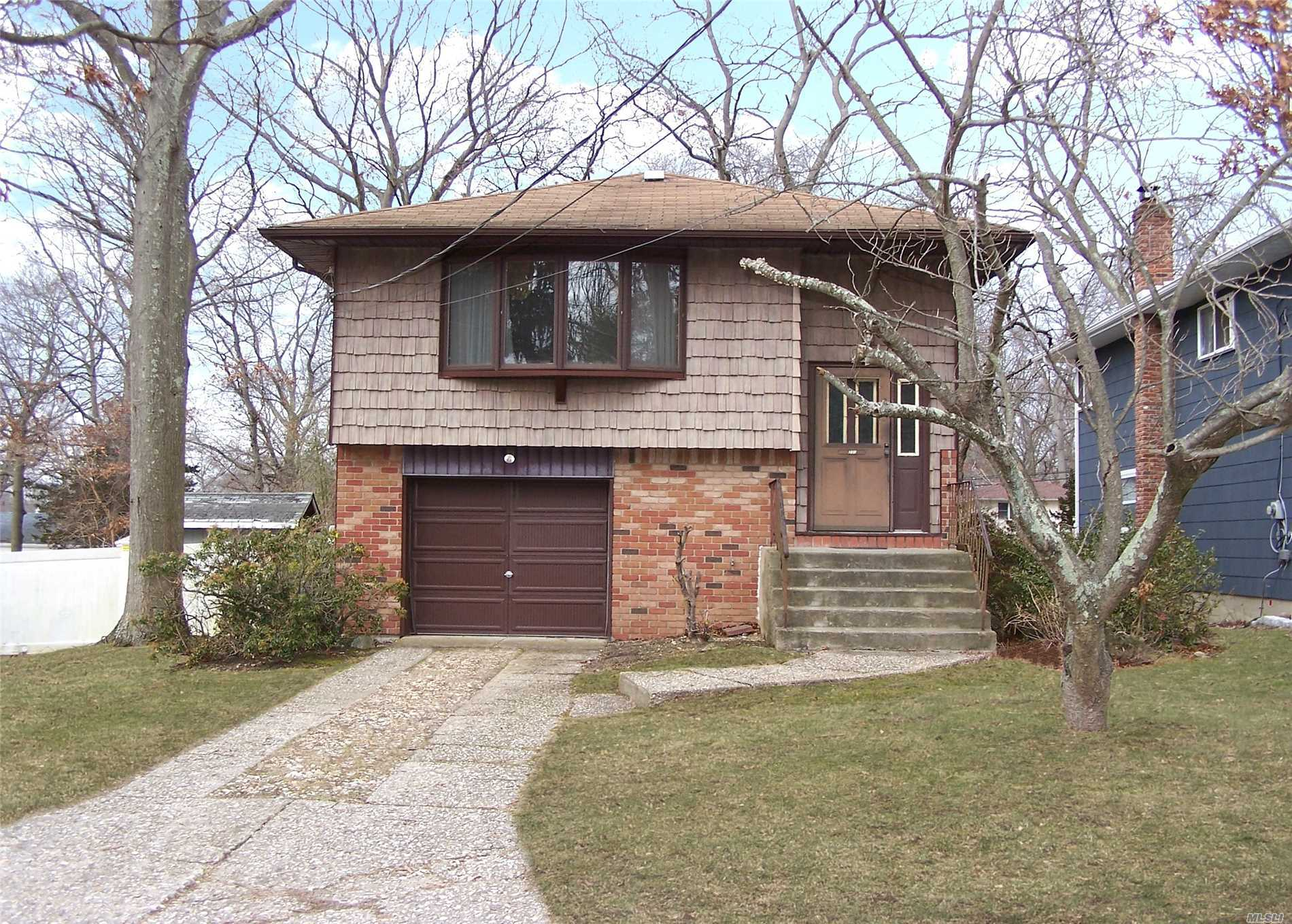 Hi Ranch In Connetquot Schools, Features 3 Bedrooms, 1 1/2 Baths, Living Rm, Dining Room, Eik, Den, Laundry Rm, Large Deck And Attached Garage.