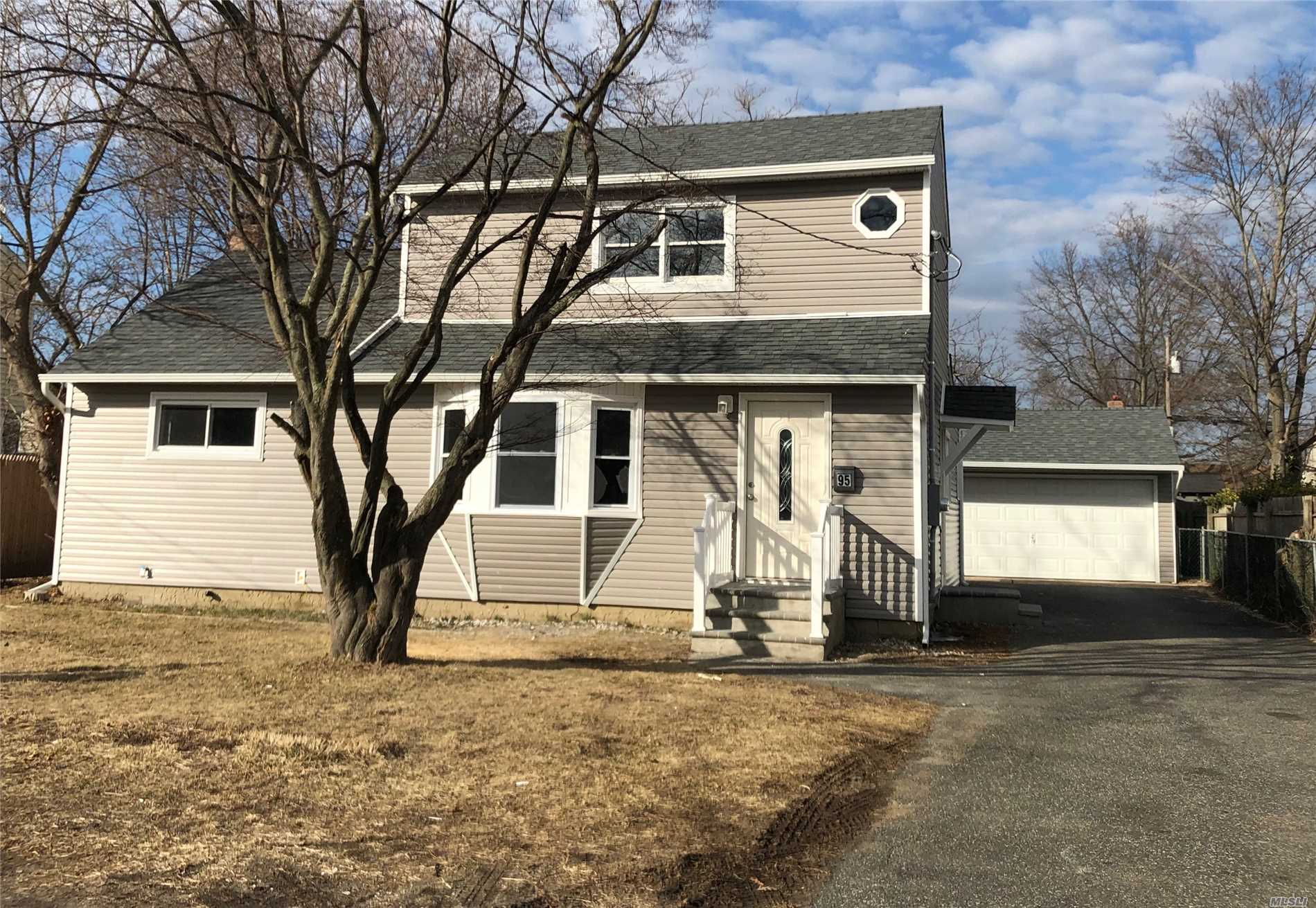 Renovated Cape With Bright Living Room And Crown Moldings, New Kitchen W/Stainless Steel Appliances, New Bathrooms, Master Bedroom With Bath And Walking Closet. New Roof, New Siding, All New Electrical & Pluming, Large Finish Basement.