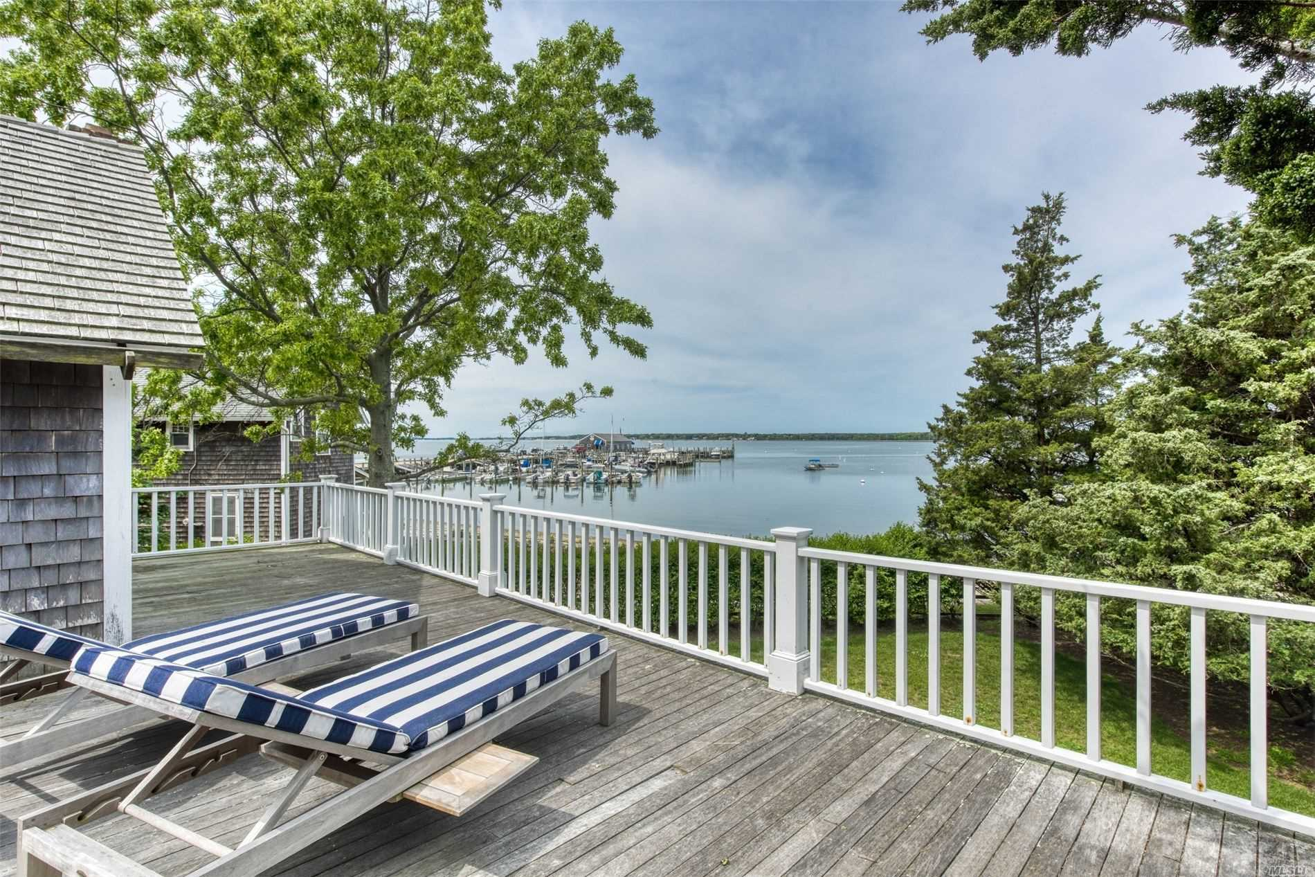 Enjoy Summer In The Crown Jewel Of Orient Village. Restored & Meticulously Maintained With Original Exposed Beams, Wide-Plank Floors, Period Hardware, 3 Updated Wood Burning Fireplaces, Custom Cabinetry & Woodwork. 2 Large Decks Span The Back Of The House Overlooking Orient Harbor & Yacht Club. June $14, 000; July $22, 000