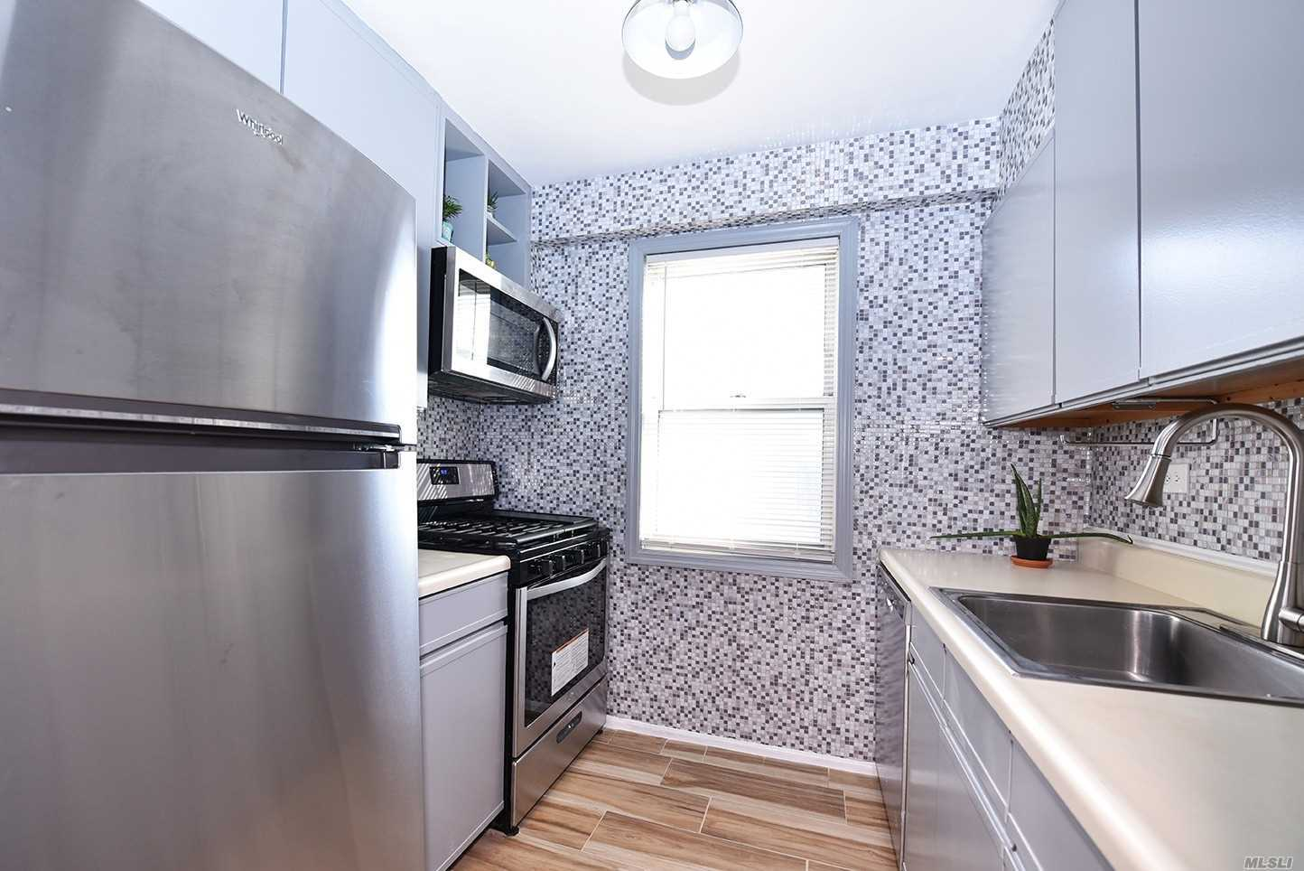 Welcoming And Radiant, This Spacious 1 Bedroom 1 Bath Corner Unit In The Coronet Is One-Of-A-Kind. This Fully Renovated Apartment Is Complete With Lots Of Natural Lighting, Open Space, And A Large Terrace. The Building Features On-Site Parking, A Doorman, A Full Time Super And Is Located In The Prestigious Jamaica Estates On A Quiet Residential Block, Just Steps Away From Town, Shopping, Buses, And A Few Blocks Away From The 179St Subway Station.