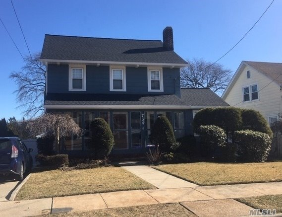 This Colonial Is A 2-Family By Permit, Owner Occupied. Features A Charming Enclosed Front Porch, Hardwood Floors, 5 Bedrooms, 2 Full Baths, 2 Living Rooms, 2 Eat-In Kitchens, Gas Fireplace, Full Unfinished Basement, Walk-Up Attic & Garage. Also New Archet. Roof, Igs, Screened House & Deck.