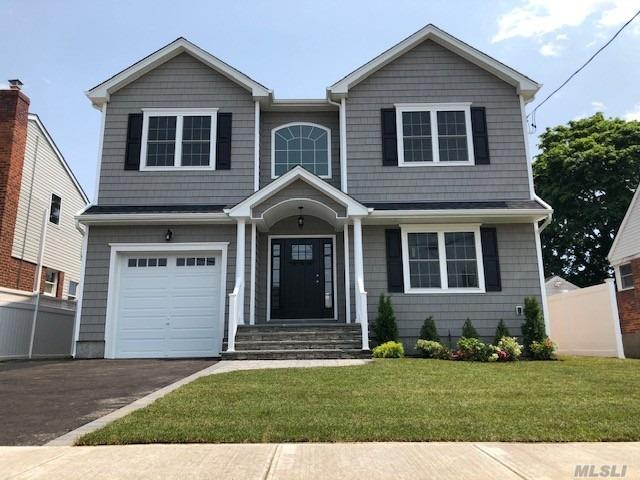 Magnificent Brand New Colonial, One Of A Kind, 4Br, 2.5Ba, Grand Entrance To Stunning Wide Staircase, 9'F/F Ceiling, Lr, Formal Dr, Eik Granite Island, W/S.S.Appliances.Den, W/Gas F/P, Breathtaking Crown Molding & Wainscoting On F/F Leading To The 2nd Floor.Master Suite W/Tray Ceiling/Huge Full Ba With Shower Stall & Jacuzzi Tub. 3 Nice Size Br, Full Granite Bath, 2nd Fl Laundry Room, 4 1/4 H/W Floors Throughout. Full Basement, 8' Ceilings, W/Ose, 8' Garage Door W/High Ceilings, Energy Star Home