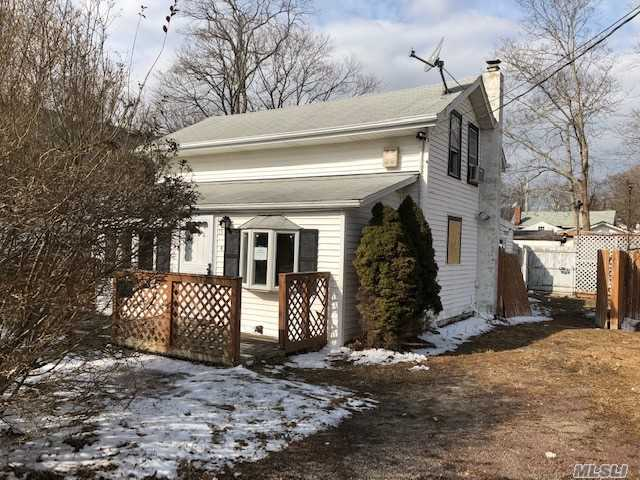 This Is A 2 Bedroom One Bath With Jacuzzi Tub Cape Style House. There Is Room For A Third Bedroom. The Utilities Are In The Crawl Space. Located In A Residential Area Close To The Water. Close To Shopping. Huge Potential Must See