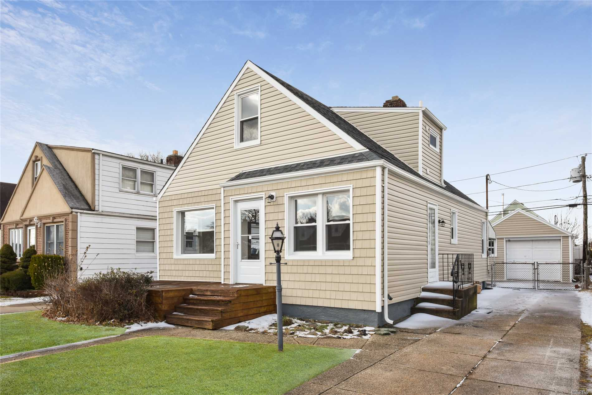 Elmont. Beautifully Renovated House, New Siding, New Kitchen, New Appliances, New Bathrooms, New Windows, Open And Bright. Great Location. Near Everything.