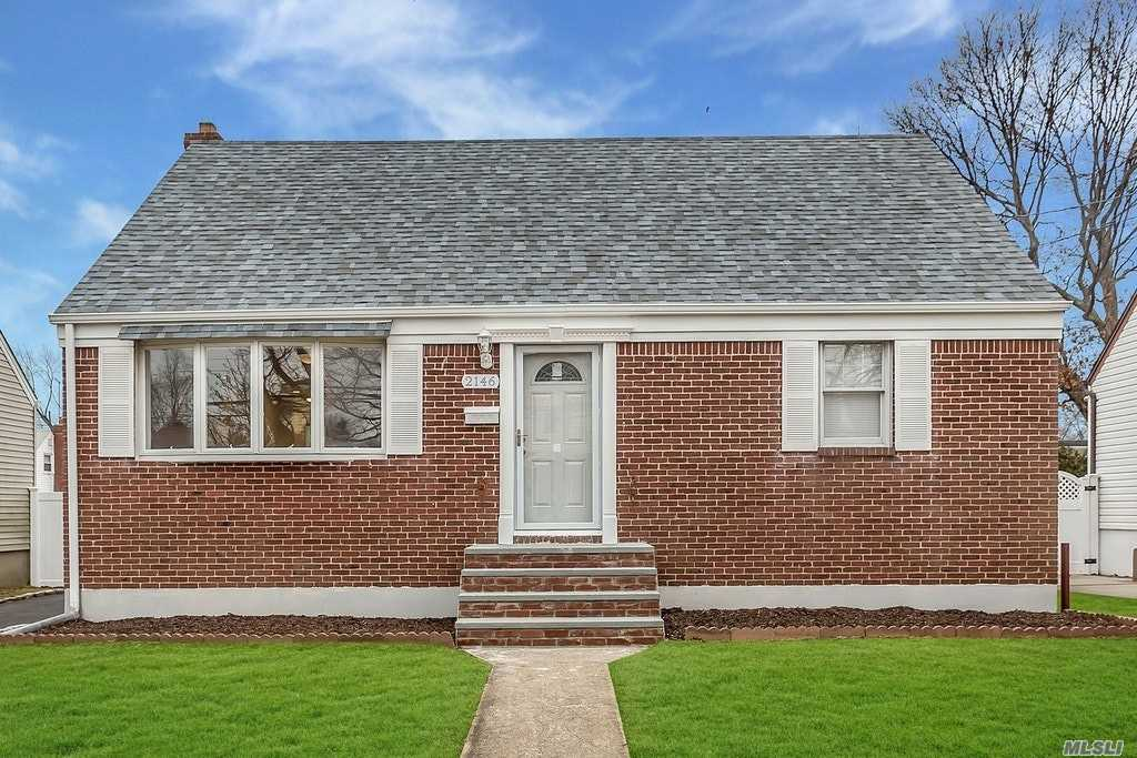 Completely Updated Diamond Condition Cape. Rear Deck With Nicely Landscaped Yard.