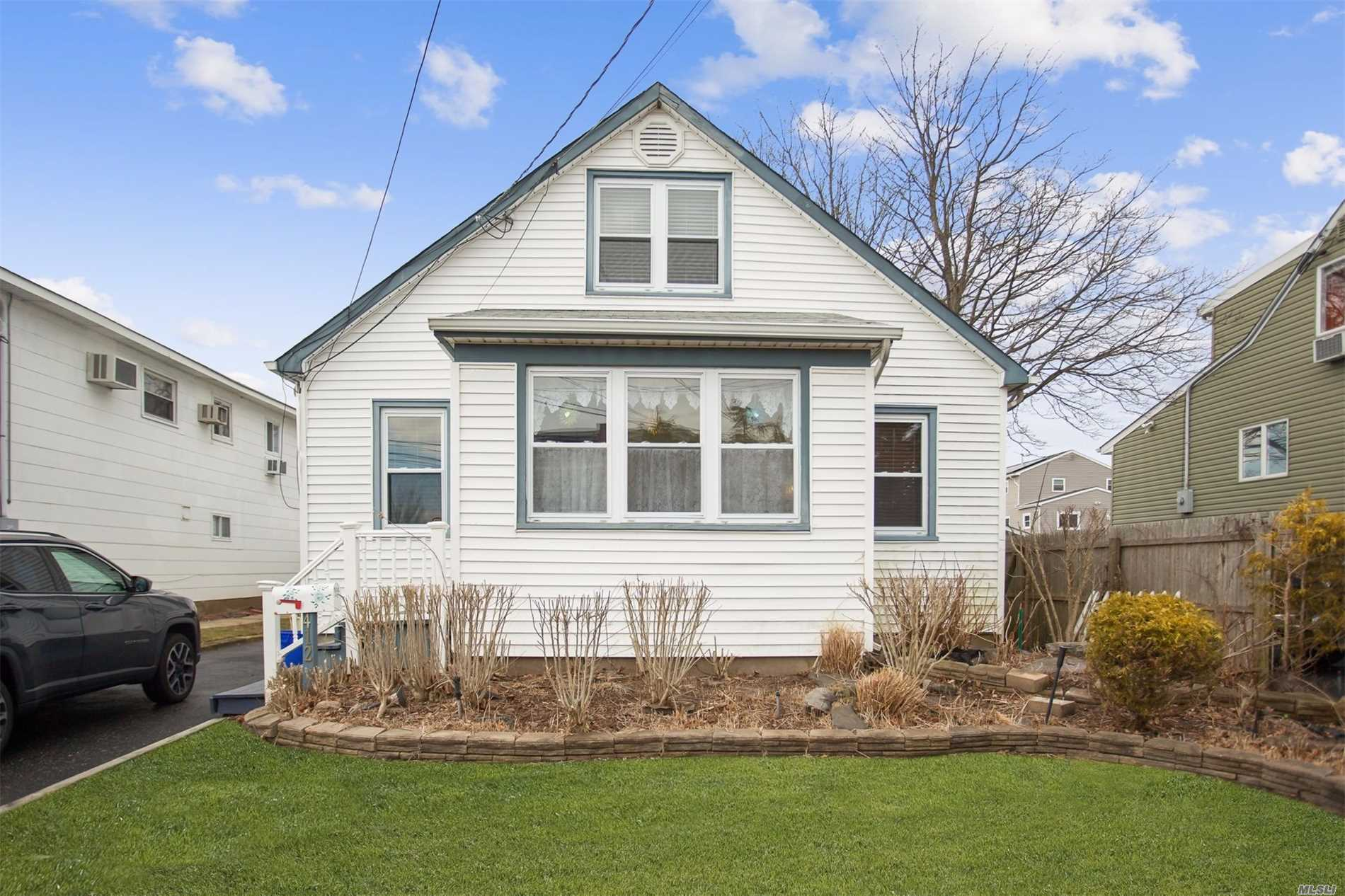 Adorable Charming Cape Located In Babylon Village. Close To Restaurants And Across The Street From Small Park. Sunny Porch With Southern Exposure, Updated Large Kitchen, Small Easy T Maintain Yard.Det One And A Half Garage.