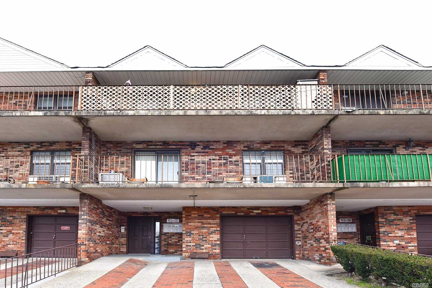 Bright One Bedroom Brick Condo Converted Into A Junior 4. Extra Bedroom W/Closet Space Fits Twin Bed. Fully Renovated Bathroom, Updated Kitchen W/Stainless Steel Appliances & Granite Counter Tops. Modern Light Fixtures Throughout. Travertine Marble Floors Underneath Flooring In Living Room. Twenty Foot Private Tiled Balcony W/Gorgeous Views & Storage Bin. Private Storage Space In Basement W/Clothes Washer & Dryer. Includes Private Parking Spot. Walk To Shopping Ctr, Buses & Minutes To L.I.R.R.