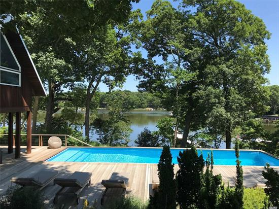 This Spectacular Home Has Been Featured On The Travel Channel And In Multiple Magazines, Including Dwell. A Full Wall Of Windows Maximizes The Incredible Views. Over One Acre Of Beautifully Landscaped Property And 304' Of Waterfront. The Main House Features 3Br All En Suite, Gorgeous Chef's Kitchen, Great Room W. A Killer Fpl, Dining Space, A Loft/Den, Finished Basement, Pool, Hot Tub, Outdoor Fpl, Pool House/Cabana W. A Full Bathroom, 2 Outdoor Showers And A Dock! What More Could You Ask For?
