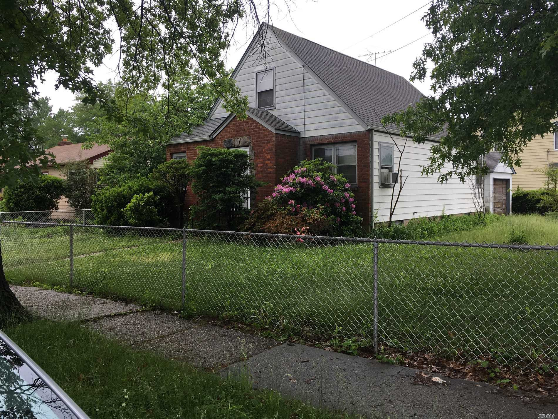 Great Location! Near All. Fenced.  Needs Work.