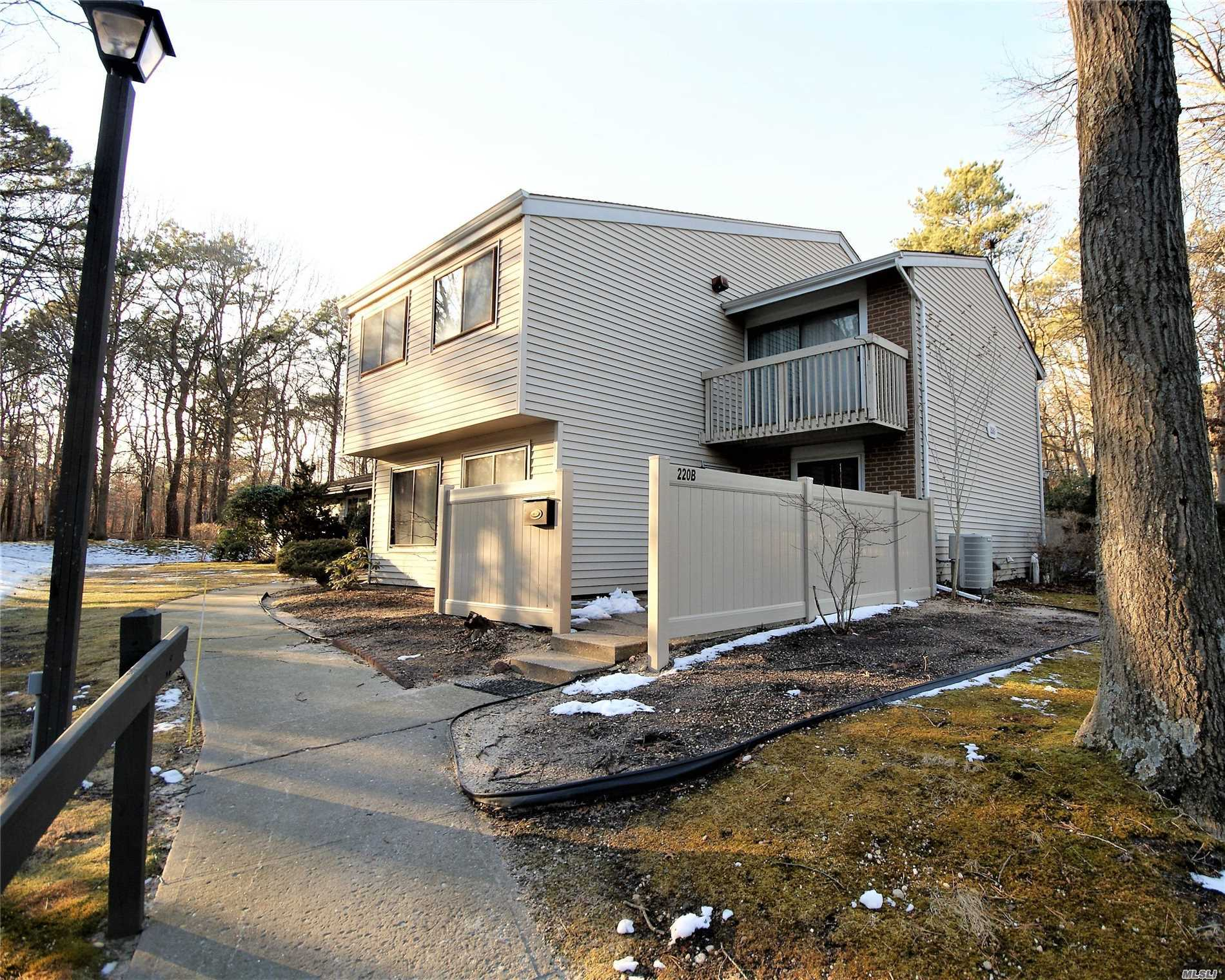 Quiet Private End Unit Located In Middle Of Woodgate Village Overlooking Woods, Next To Golf Course! 3Br Unit - Now 2 Brs. Can Easily Be Convert Back To 3Brs. Private Balcony Off Master Bedroom, Updated Bathroom, Wood Floor 2nd. Bedroom, Kitchen With Updated Counters, Cabinets & Floor. Close To Long Island Railroad, Islip Airport, Downtown Patchogue & 15 Minutes From Stony Brook University/Hospital.