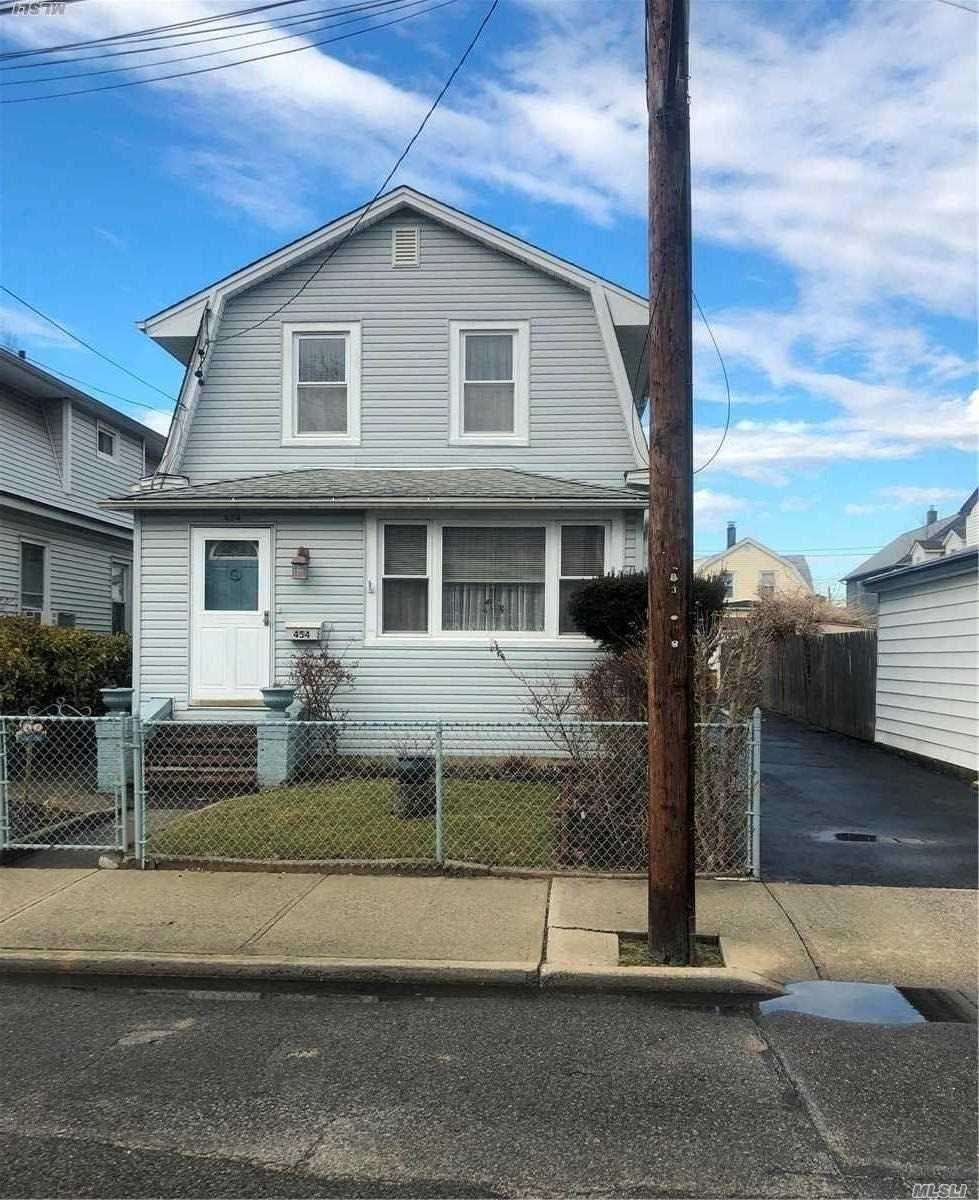 Lovely 3Br, 2 Bath Well Maintained Colonial In The Heart Of Cedarhurst, Super Low Taxes, Nice Yard, Close To All.