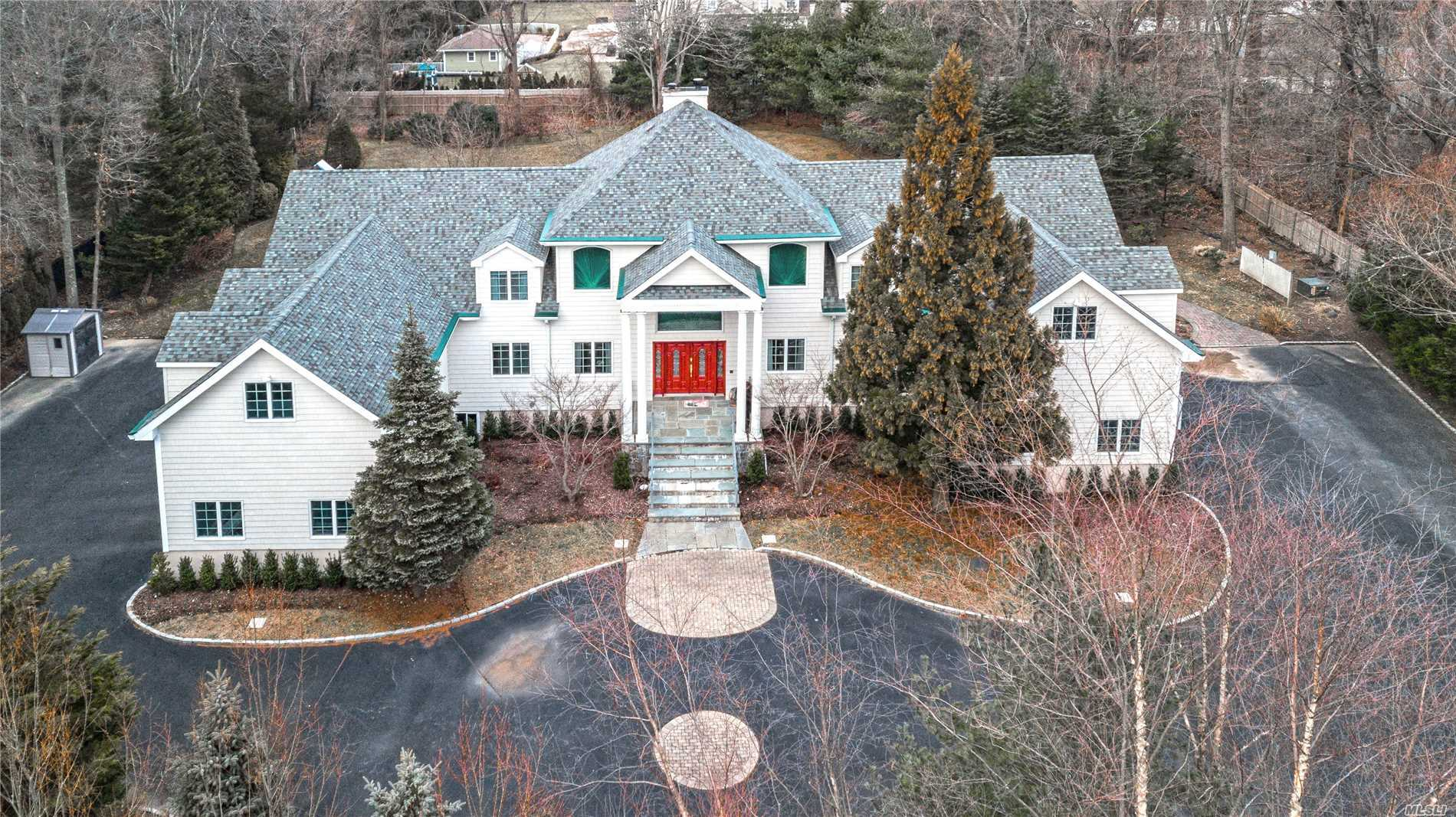 Elegant Estate Setting With Gated Long Driveway. Magnificent 6500+ Sq Ft Colonial On 1.79 Acres, Architecturally Dramatic 2 Story Foyer With Sweeping Staircase To 2nd Floor Balcony. Interior Is Accented By High Ceilings, Archways, Detailed Moldings & Intricate Woodwork. Grand Principal Rooms Are Perfect For Entertaining Including A Home Theater & Gym In Finished Basement. 2 Master Suites one on Main Level! Enjoy Huntington Village Restaurants, Shopping, Movie Theaters & Museum. Harborfields Sd.
