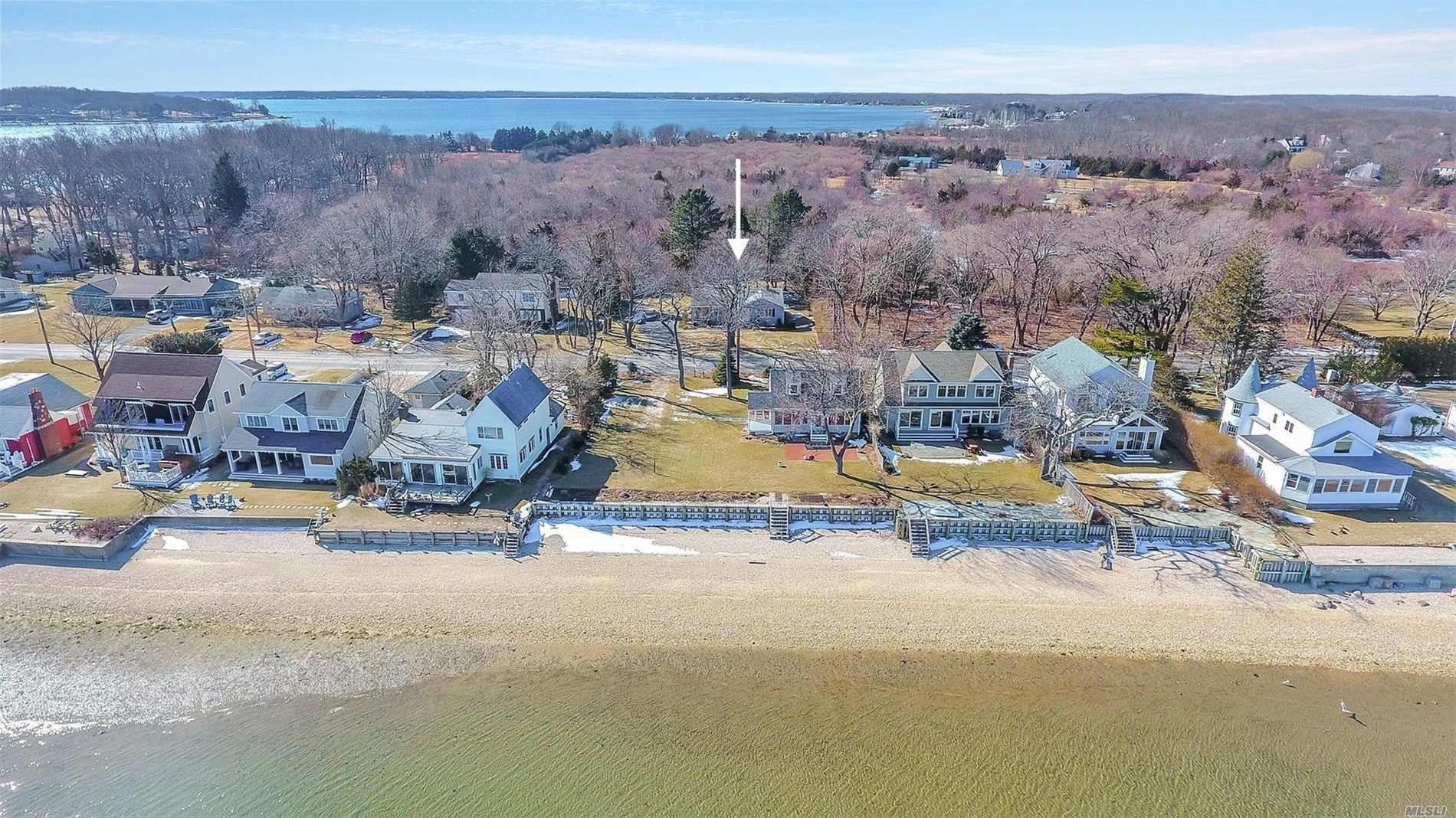 Charming Two Bedroom, Two Bath Waterview Cottage With Unobstructed Views Of Pipes Cove To Shelter Island. Easy Access To Sandy Bay Beach And Greenport Village. All Oak Flooring, Cac, Outdoor Shower, Large Rear Deck Overlooking 1/3 Acre Property. The Perfect North Fork Getaway.
