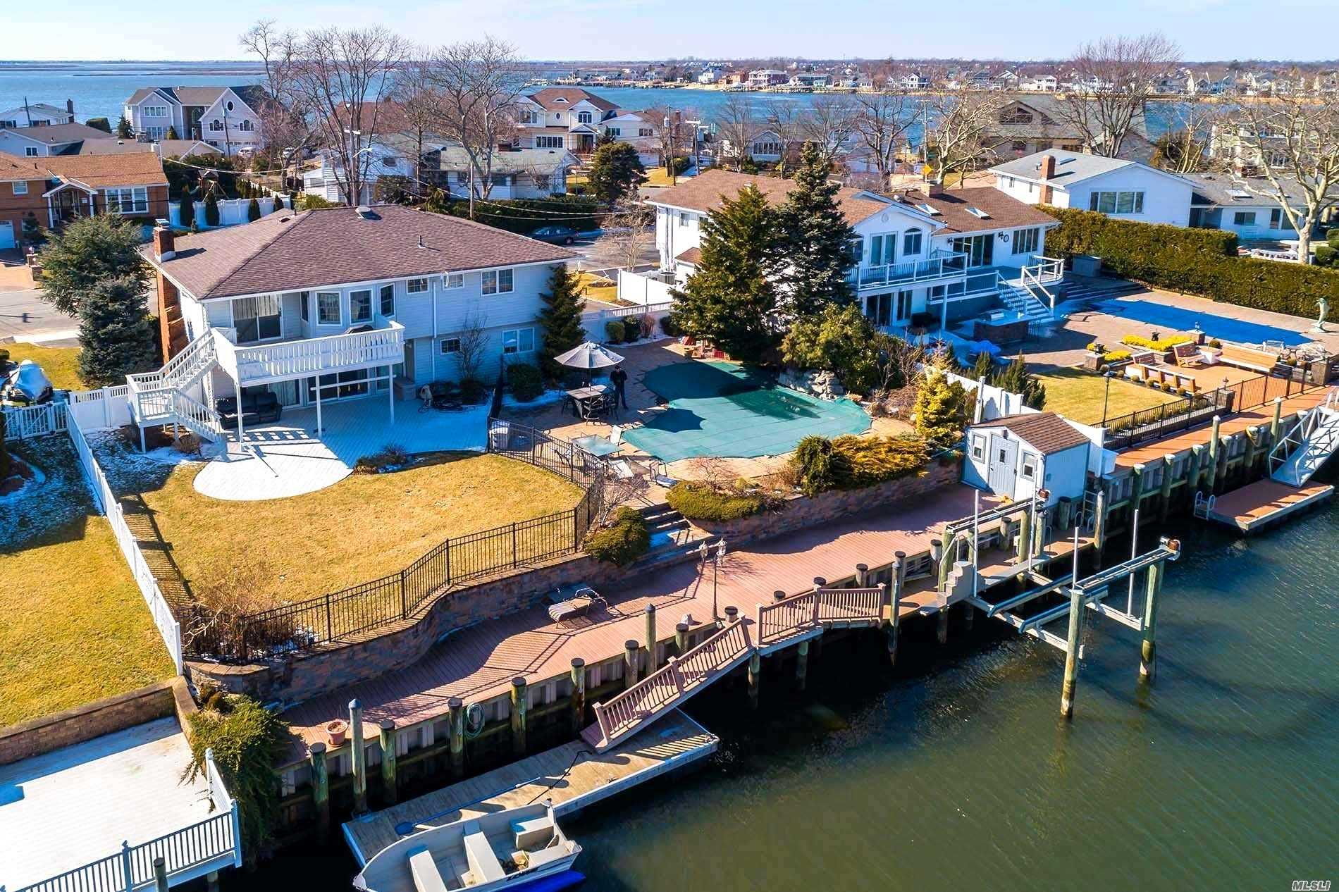 A Picture Perfect Setting For This Spacious Waterfront Home In The Harbour Green Estates Community W/ A Resort Backyard Setting W/Ig Heated Vinyl Pool W/Waterfall, Navy Corrugated Bulkhead, Boat Lift, Ramp & Dock For Wave Runners & Literally 2Nds To The Bay..A Boater Dream! This Home Boasts A Great Open Floor Plan, Central Air, Hardwood Floors On 2nd Level, Wood Burning Fireplace In The Fam Room, Sep Laundry Area, Newer Roof, Fenced In Backyard! Present Flood Insurance Is $532./Year! Wow!