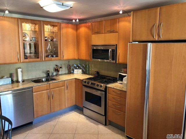 Fabulous Bay Club Gated Community. 24 Hr. Security. Doorman / Concierge* *** Very Rare**** Extra Large.. Deluxe Jr.4. Master Bathroom + Guest Bathroom!! Dining Room Or Extra Bedroom. Terrace. Water & Pond Views. Fully Designer Renovated. **See Photo Attachment For All The Details** Year Round Swim & Fitness Center, Indoor Parking (Extra Fees). Free Tennis Club. Underground Stores. On Premises Restaurant. Best Location. Near Everything.