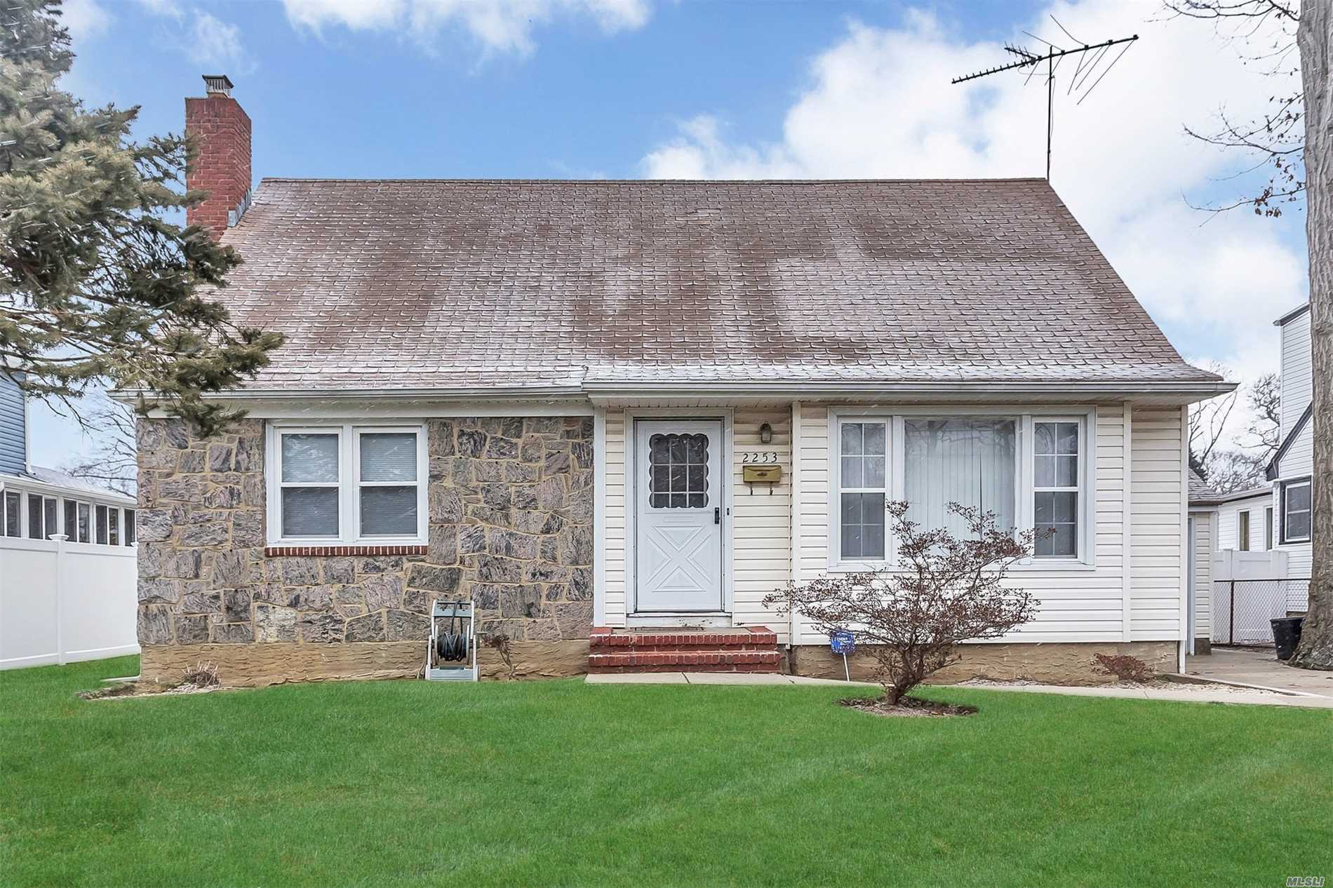 Move In-Condition 5 Bdrm Cape. Large Living Rm, Eik, 4/5 Bedrooms, Hw Floors, Attached Garage, Beautiful Yard. Updates Include: Replacement Windows, Bath, Electric, Driveway. Gas Heat. Priced To Sell!!