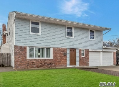 Close To Private Resident's Only Beach, Spacious Splanch With Wood Floors And Large Rooms Throughout. New Front Vinyl Siding, New Windows, New Pella Doors To Nice Size Backyard, Central Vac, Floored Attic, 3 Car Garage. Beach Block! 2 Driveways.
