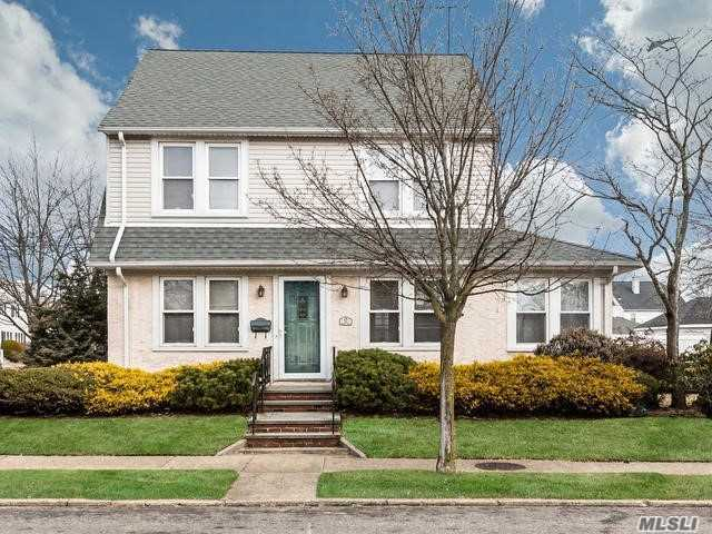 Welcome To This Spacious Colonial In Desired Herricks School District! Great Corner Lot W/Private Yard & huge 1.5 Car Garage. The Main Level Offers A Large Living Room Flowing Seamlessly Into The Formal Dining W/Adjoining Light & Bright Den/Sitting Room. The Kitchen Provides Access To Back Patio & Partially Fin'd Basement. 2nd Level: 3 Generous Sized Beds & Full Bath. Proper Staircase Up To Fin'd Space/4th Bed. Hardwoods Thruout, Freshly Painted. Solid House With Lots Of Potential! Sold 'As Is'
