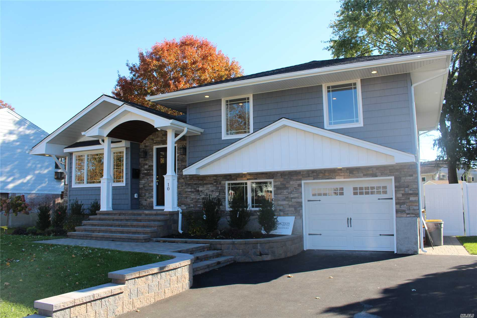 Completely Renovated Split Level. Barrel Front Portico W/Bead Board Ceiling. All New Kitchen W/Quartz Contertops & Ss Appliances Incl Microwave. 2.5 New Baths, New Cac, Refinished Oak Flooring Many Hi Hates! Crown Moulding New Anderson Sliding Door In Dr, New Architectural Roof New Siding With Front Stonework, New Pavers Patio New Elec Garage Door And Driveway New Igs Prof Landscaping