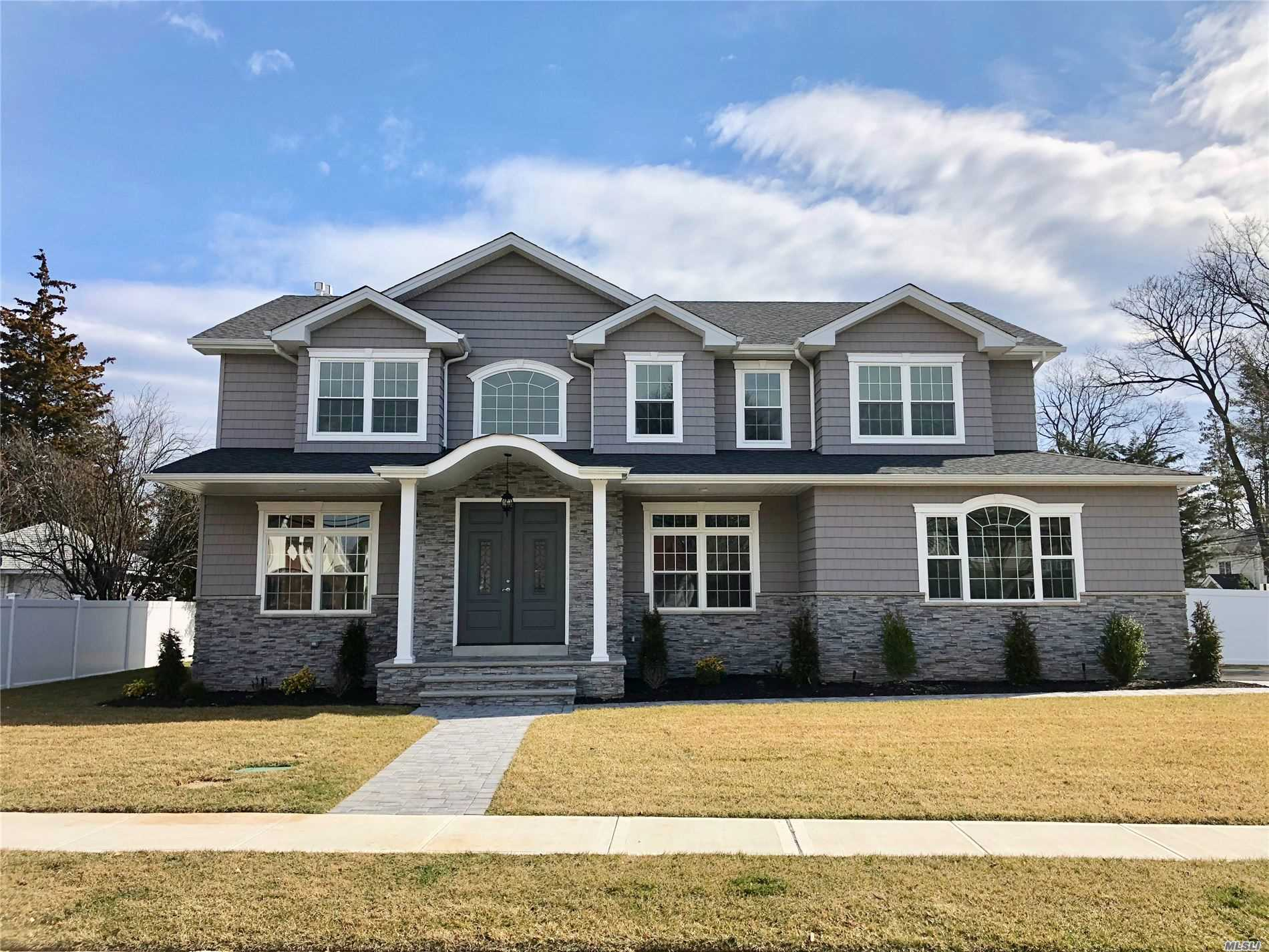 Prime North Syosset! 3800 Sq Ft. Home Featuring A Grand 2 Story Entrance,  5 Bedrooms, 4.5 Bathrooms, , Sun-Filled Master Br W/Tray Ceiling,  His And Hers Wic, State Of The Art Kitchen W Center Island + Ss Appliances,  Walk In Pantry , Bedroom On Main Level W/ Full Bath . Den W/ Gas Fireplace,  Laundry Rm On 2nd Floor, Full Basement W Ose, Fenced Back Yard,  Process Of Being Built..