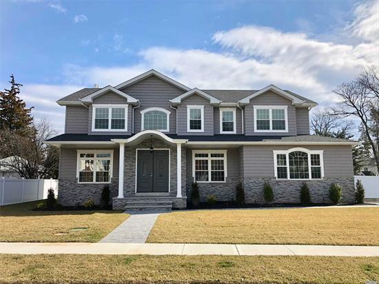 Prime North Syosset! 3800 plus Sq Ft. Home Grand 2 Story Entrance, Transitional style 5 Br, 4.5 Ba Sun-Filled Master Br W/Tray Ceiling,  His And Hers WIC, State Of The Art Kit. W Center Island + Ss Appliances,  Walk In Pantry , Bedroom On Main Level W/ Full Bath . Den W/ Gas Fireplace,  Laundry Rm On 2nd Floor, Full Basement W Ose, Fenced Back Yard..Buyer Responsible To Pay Transfer Taxes, Final Survey, Water& Sewer Fees..