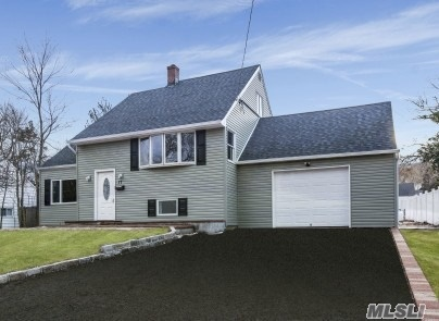 Newly Renovated W/No Expense Spared. Expanded Split Level With Crazy Low Taxes!! Open Floor Plan. Custom Kit W/White Shaker Cabinets, Quartz Counters & Ss App. 2 Custom Tiled Full Baths, New Dark Walnut Wood Floors. 200 Amp Elec, New Siding, Boiler, Driveway. Add Updates Inc Windows, Water Tank & Roof.