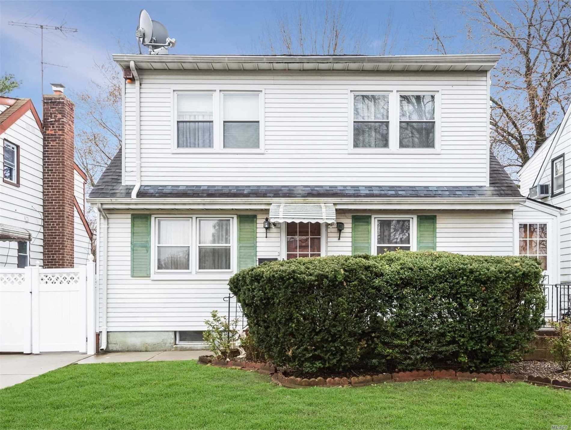 House Located At Right On Boundary Line With Flushing, House Features 4 Beds, 2.5 Bath, 2 Kitchen, Hardwood Throughout, Mother & Daughter Floor Layout. House Fully Renovated Years Ago, New Boiler. 1/2 Block To Kissena Park & Bus Q65. House Close To Supermarket, Highway, Zoned For Top School District ( 26 District )