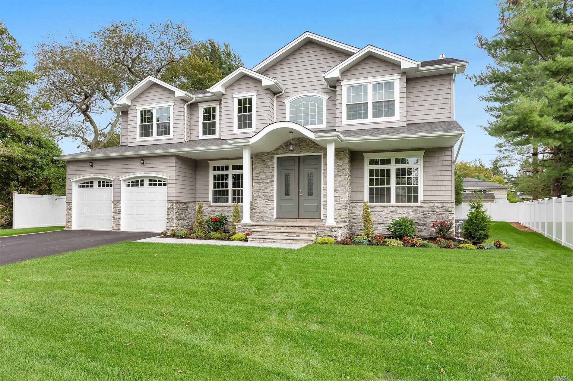 50% completion! Prime North Syosset ! 3800 Sq Ft. Home Featuring Grand 2 Story Entrance, Hardwood Floors Throughout,  5 Bedrooms, 4.5 Bathrooms, , Sun-Filled Master Br W/Tray Ceiling- His + Hers Wic, Designer Kitchen W Center Island And Ss Appliances, Walk In Pantry, 1 Bedroom On Main Level W/ Full Bath- Den W/ Gas Fire Place - Full Basement W/ Ose. Fenced Back Yard . Other model available for show