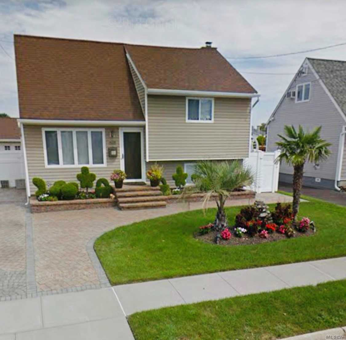 Beautiful Updated Waterfront Split Located On Extra Wide/Deep Canal Seconds To Theopen Bay Across From Copiague Harbor. 3 Bedroom (Master Has Custom Built Ins For Plenty Storage), 2 Full Baths, New Granite Eik With Stainless Steal Appliances W/ Pella Sliders To Bayckyard , L/R, F/R All With Radiant Floor Heating, Seperate Outside Entrance, Paver Driveway And Backyard, Professionally Landscaped, Palm Trees, Above Ground Pool Summer Oasis Right In Your Backyard, 1.5 Car Garage W/Seperate Storage Area