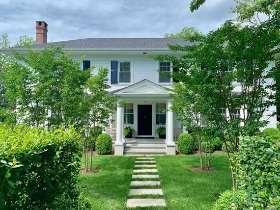 Stunning 1920S Colonial In Perfect South Village Location. Completely Renovated Home Is In True Move In Condition. Large Center Hall With Access To Formal Dining Room, Formal Livingroom W/ Woodburning Fireplace. Large Comfortable Family Room. Open Eat-In Kitchen. Full Basement, 4 Car Garage. Unique Half Acre In Bellport Village Which Runs Street To Street!