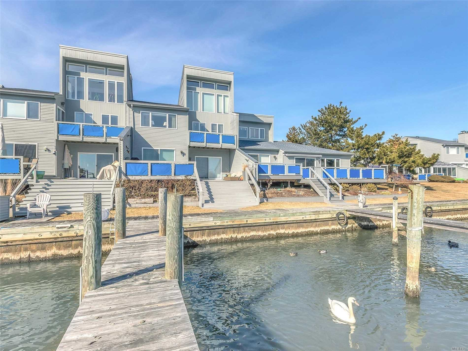 Beautiful Waterfront 3 Story Condo! Breathtaking Views Of Fire Island! This Pristine Unit Features Vaulted Ceilings, Eat In Kitchen W/Granite Countertops, Hardwood Floors, 2 1/2 Baths, Which Includes Master En Suite W/Jacuzzi & Sep. Stand-Up Shower, Custom Blinds, Lr W/Fireplace, Outdoor Entertaining Area, Boat Slip And Finger Dock. Resort Style Living Also Includes Tennis Courts, Clubhouse W/Gym & Saunas. 24 Hr. Guarded Security. A Must See!