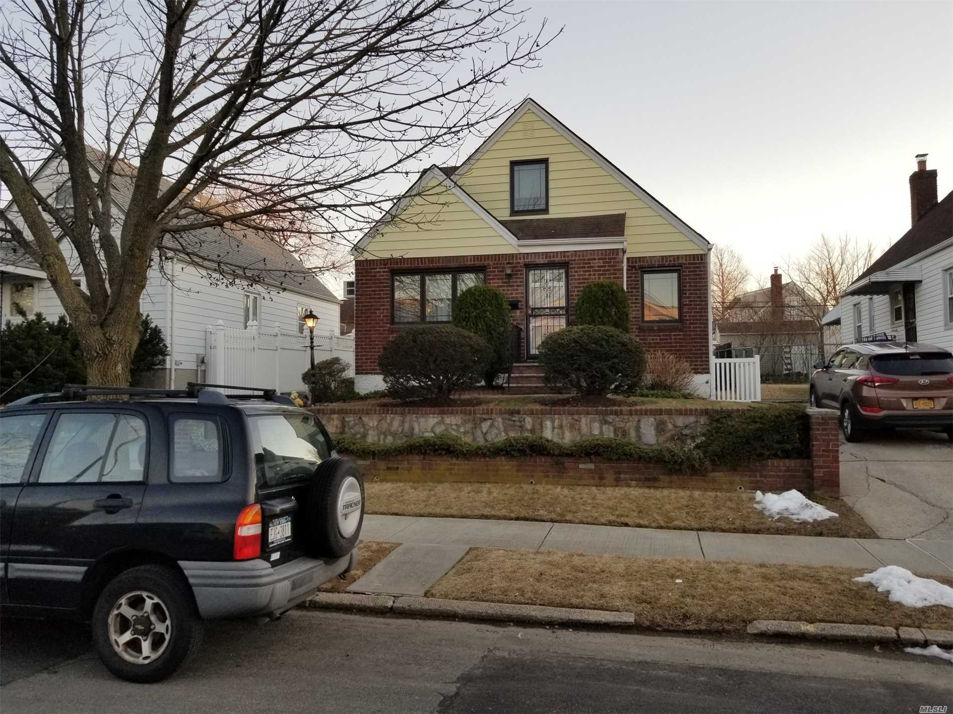 Highly Attractive Detached One Family Cape Home For Sale. Features One Large Bedroom On 1st Floor. Den Leading To Rear Of House Handicap Wood Ramp.Full Bath. Eik W/ Breakfast Nook. 2nd Floor Two Bedrooms & Plenty Of Storage. All New Windows Thru Home. Large Pvt. Backyard. One Car Detached Garage. Pvt. Driveway. Finished Basement W/ Family Room