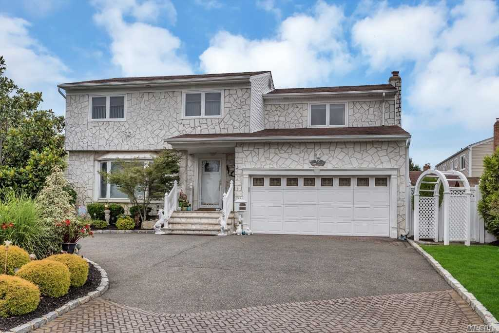 Prestigious Biltmore Shores 4 Br, 2.5Bth Spacious Colonial W/Cac, Fin Bsmt, Circular Drvwy & Water Views Of The Bay On 100X100 Prop! Large Updated Eik W/Granite Counters, Stainless Appl's.Den W/Fpl.King Mbr W/Huge Wlk-In & Master Bth.All Bedrooms Are Large.Entertainer's Bkyd W/8' Deep Salt Water Ig Pool, Lcd Rainbow Lighting & 4Yr New Liner.Stone Facade, Andersons, Cac, Gas Hw Heat 200Amps, Generator, Pvc Fencing, Sd# 23-Birch La Elem, Beach Club/Marinia. Zone X-Flood Insur $590.00 Year.