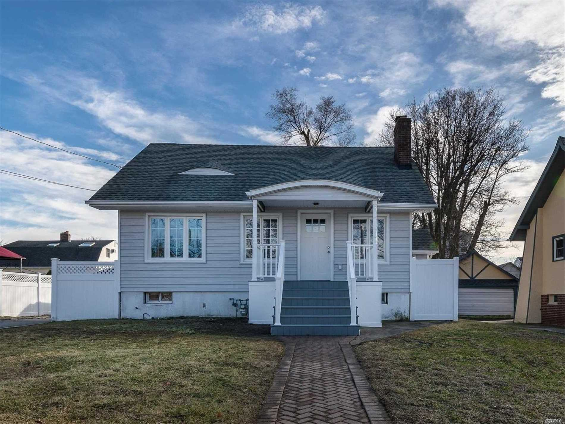 Renovated Cape On Quiet Street. Great Alternative To A Condo. Open Floor Plan. Beautiful Kitchen With Stainless Appliances & Island W/Seating. Double Vanity In Bath. Wood Fireplace. 60 X 100 Property. 2-Car Garage. Fenced In Backyard W/Patio And Fire-Pit. School 8 Around Corner, Close To Shopping, Lirr, Beaches & Restaurants!