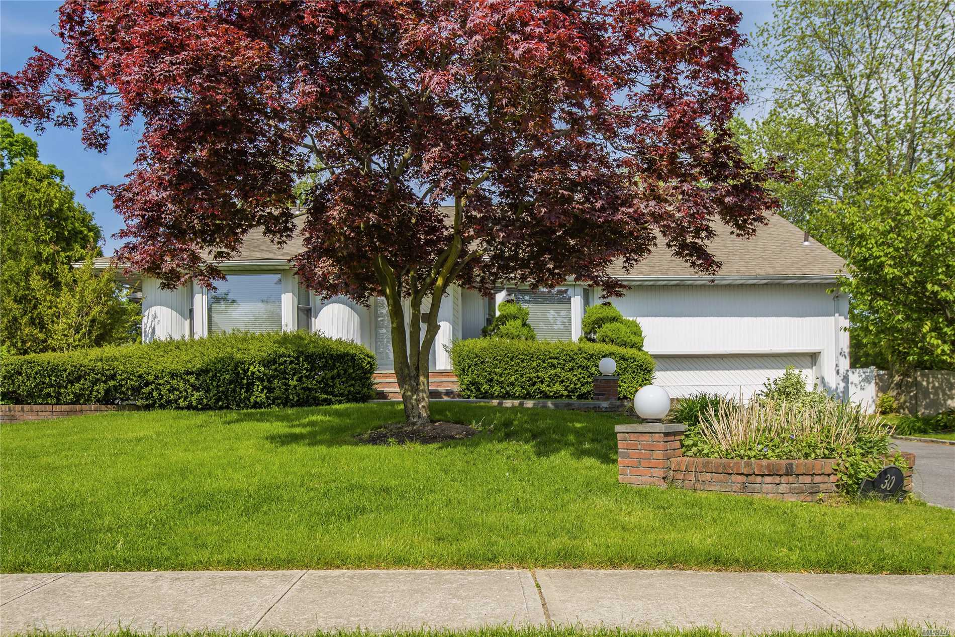 Largest Riviera model in East Birchwood! Fall in love with this inviting 4-5 bedroom (easy conversion back to 5 BR) 3 full bathroom home nestled on a deep park like backyard complete with an in-ground salt water pool! Highlights including a gourmet eat in kitchen, spacious living room with vaulted ceilings, newer hardwood floors and wood burning fireplace, bonus ground floor master suite, spacious den with fireplace, 2 car heated garage, GAS line in front of house and Jericho schools.