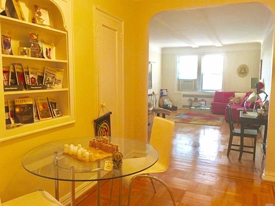 Spacious Bright Jr. 4/Two Bedroom Rental In Pre-War Condo In The Heart Of Forest Hills. Renovated Eat-In Kitchen And Bath With New Tub And Shower Stall, Dining Area, Large Closets, 1000 Sq. Ft. In All. High Ceilings, Hardwood Floors, Built-In Bookcase. Part-Time Doorman, Close To Express Subway, Austin Street Shopping And Dining. Furniture Available For Additional $500/Month.