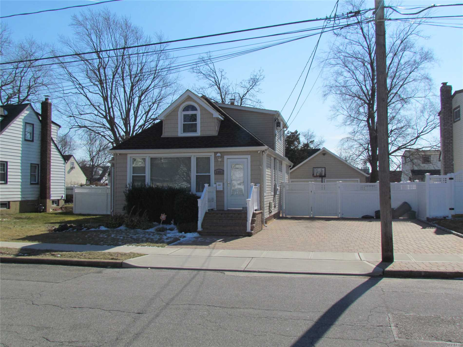 Make Sure You Bring Your Checkbook..This Is Gonna Fly.......Super Low Taxes.....Mint 3-4 Bedroom 2 Bath Cape...Totally Updated..1st Fl Master Suite..2 New Baths....Dynamite Expanded Eik W/ Island.And Stainless Appliances.....Finished Basement With Family Room And A Kids Playroom...Laundry Rm....Pavers Galore...Huuugggeeeee Brick Paver Driveway And Patio..W/ Awning...Detached 2 Car Garage..Fully Fenced...Mid Block...