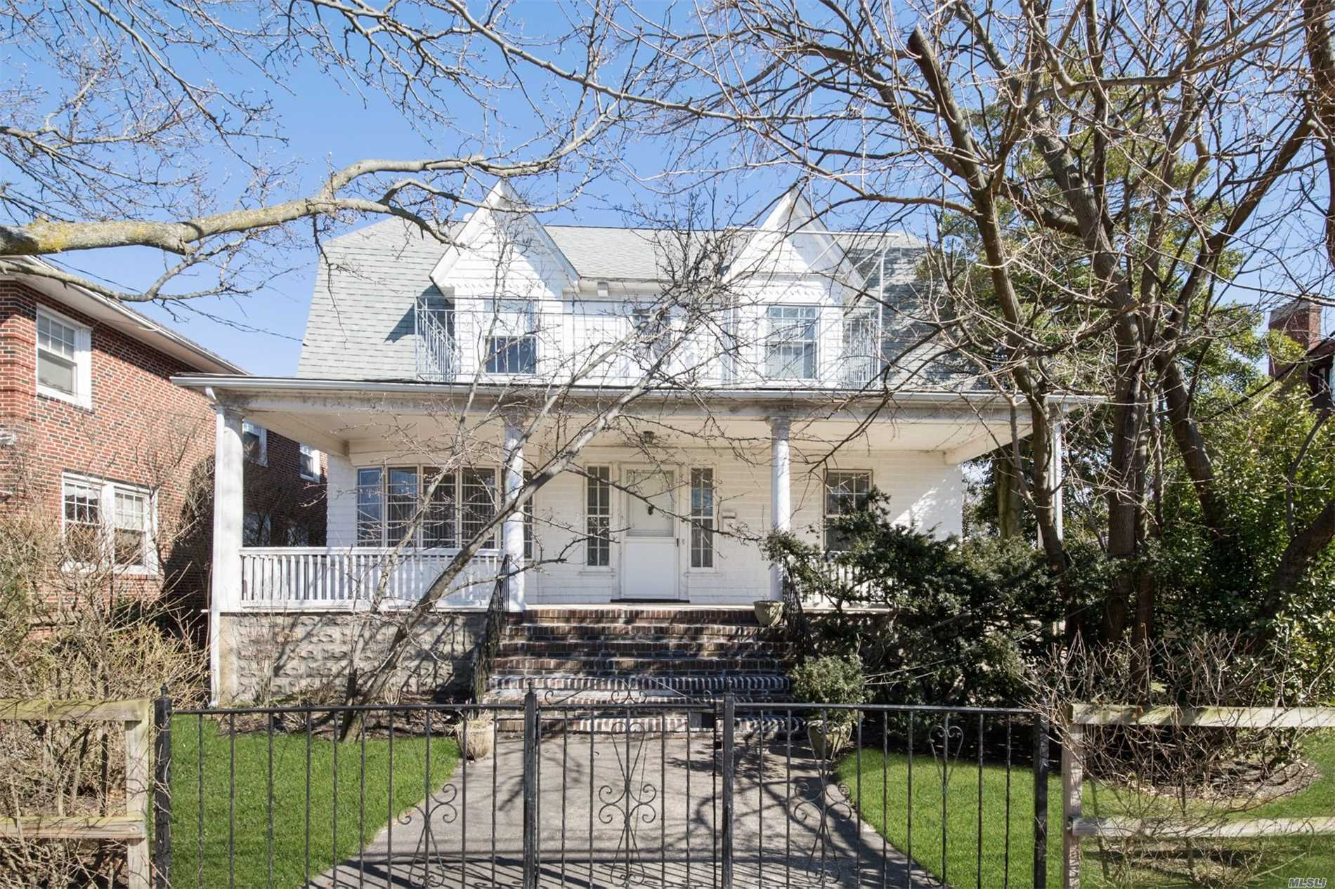 Renovate This Stately Rockaway Gem And Have One Of The Best Homes In All Of Belle Harbor! Located Just One Short Block To The Beach.Massive Front Porch, Impressive Over-Sized Front Door, High Ceilings On The Entire First Floor, Lr With Fireplace, Hw Floors, 4Br's, 3 Full Baths Plus A Walk Up Third Floor With An Additional 2Br's, Office Or Storage. Large Unfinished Basement With High Ceilings, 2 Car Garage, Large Private Back Yard And Plenty Of Parking. Legal 2 Family Used As A One. Call Today!