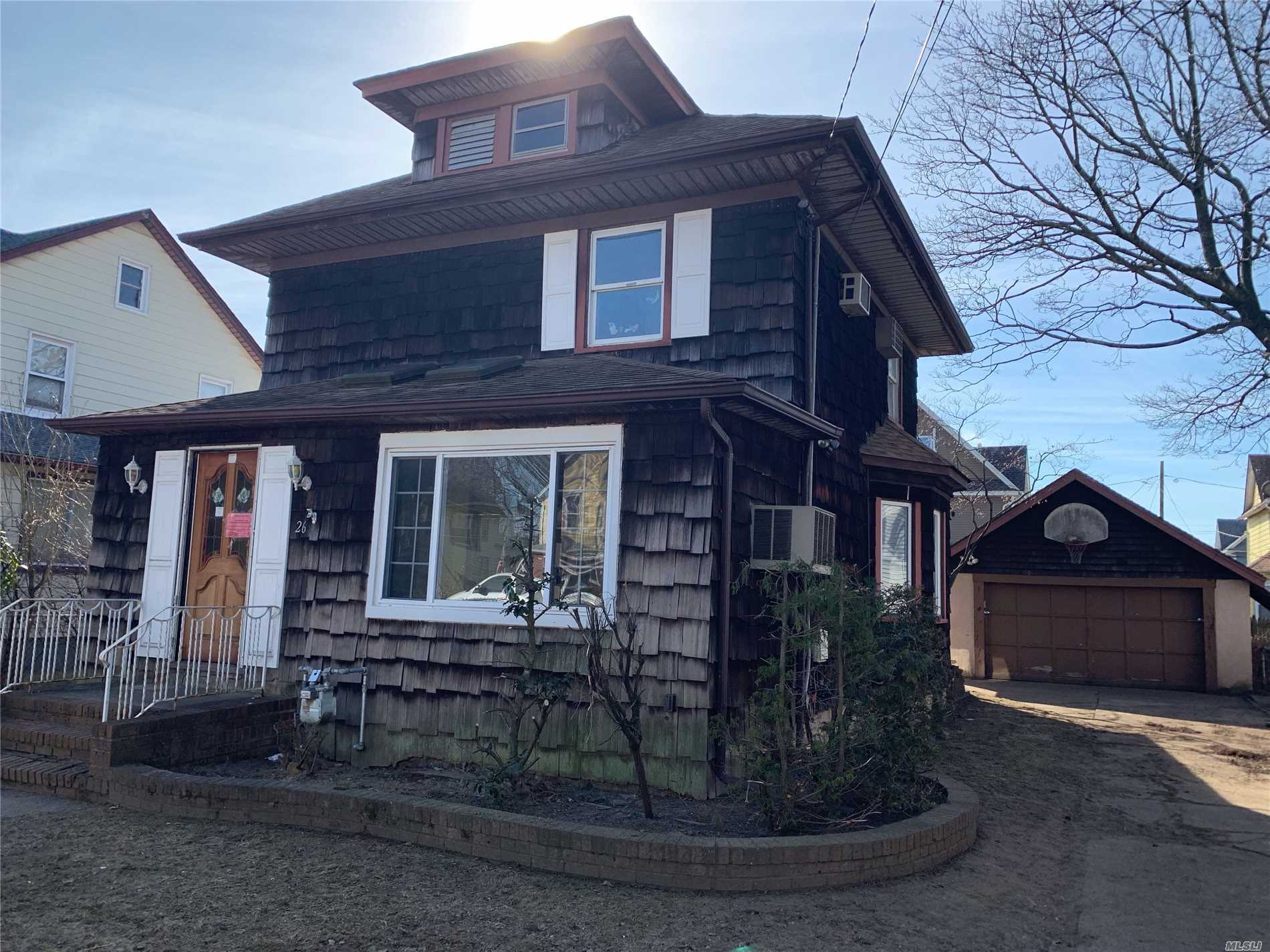 Wonderful Opportunity To Own In Historic Lynbrook* Great Home With Old World Charm And Open Floor Plan With Beautiful Sunroom Off The Large Kitchen*Long Elongated Driveway Leads To The 2 Car Detached Garage* Bring Your Creativity And Ideas And Make This Home! Close To Schools*Shopping And Major Roadways*Must See!