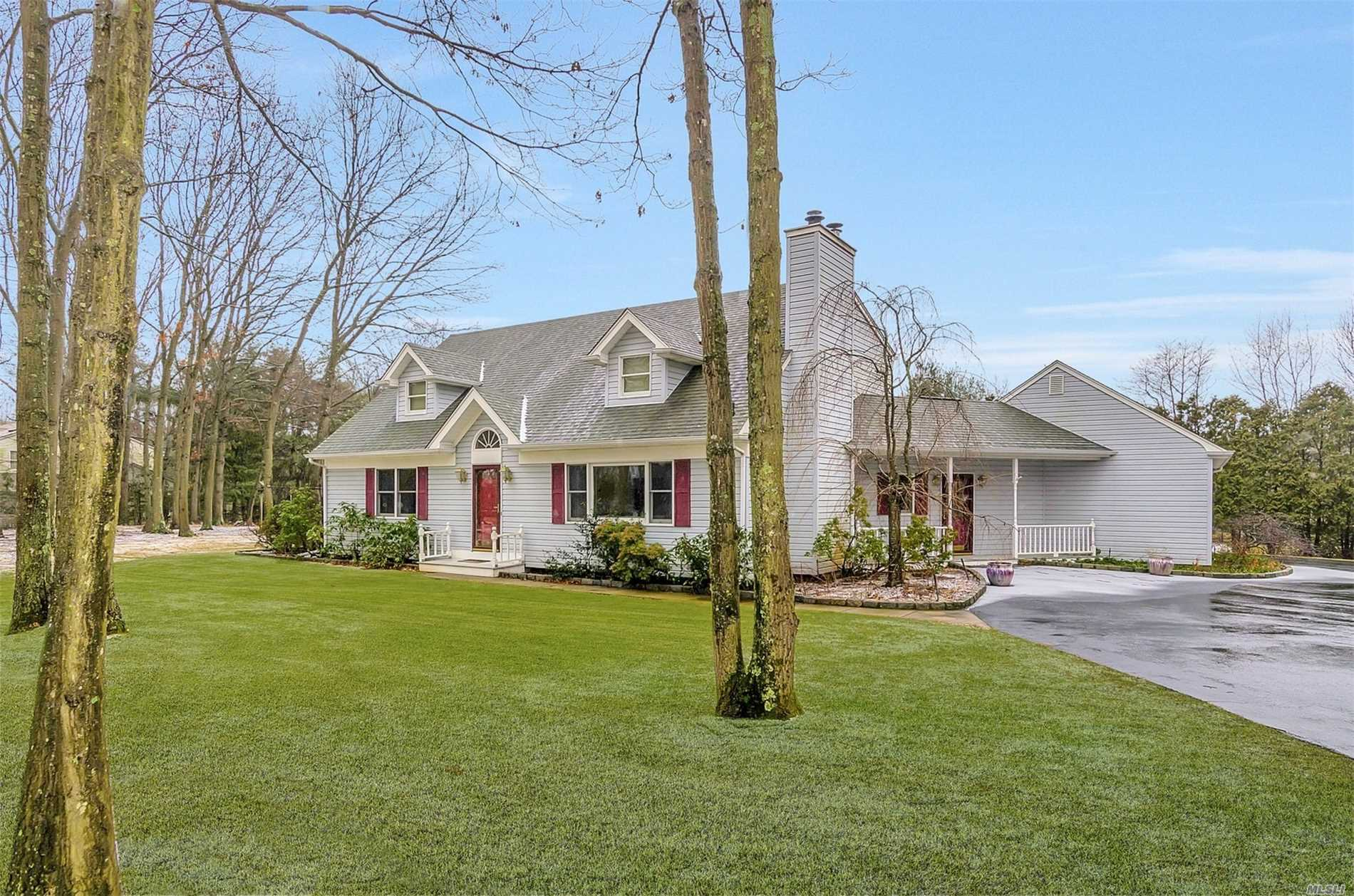 Custom Built Cape-Style Contemporary Home Set In The Quiet, Private Wading River Acres Community. Here You'll Find Real Oak Flooring Downstairs And In The Large 2nd Floor Den. Master Sized Bedrooms Both Upstairs And Down. This Home Has A Fireplace, 2 Zones Of Central Air, Vaulted Ceilings And Sits On A Lovely Mature Treed Property. It Has 2.5 Baths, A 2.5 Car Garage, A Part Finished Basement, Multi-Car Circular Driveway Parking, And Is Located On A Shy Acre Of Land. Come See It Soon!!