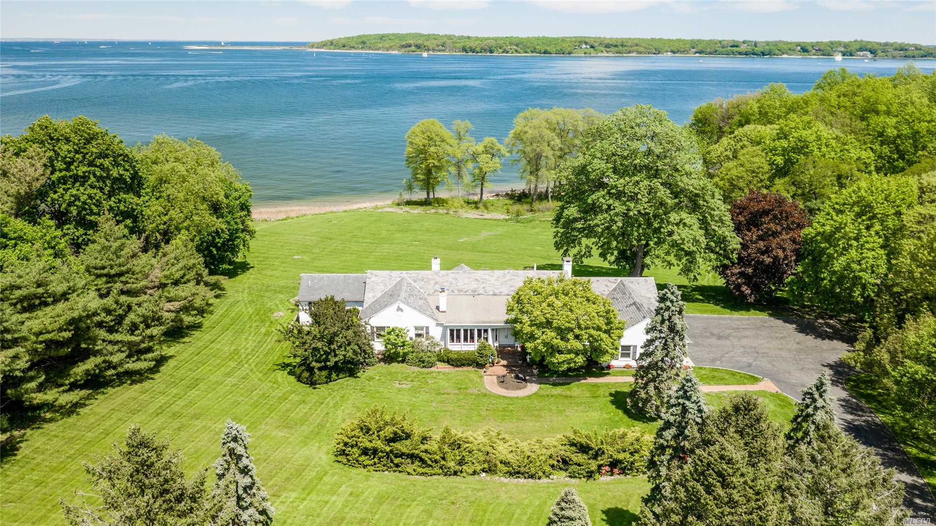 Centre Island Waterfront! Sprawling Brick Ranch Style Home On 4.28 Acres, Beautifully Situated On A Private Drive On The North End Of Centre Island! Enjoy Sweeping Views Of Cold Spring Harbor & Long Island Sound From Most Rooms.This Special Property With Rolling Lawns Offers Direct Access To 211 Feet Of Private Beachfront. A Wonderful Hamptons Alternative With A Reasonable Manhattan Commute Minutes From The Charming Seaside Villages Of Bayville & Oyster Bay! Perfect Summer Or Year Round Living!