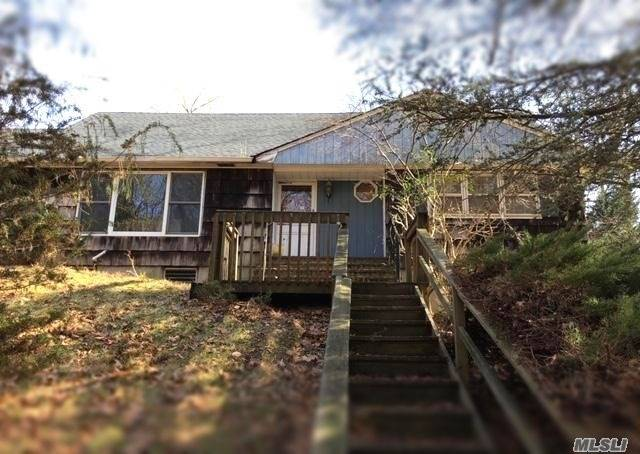 This Home Is Located On Rustic Treed Low Traffic Street Close To The Local Beach. The Tall Foliage And Long Driveway Provide Ample Privacy. The Floor Plan Has A Large Master Suite On The Main Floor. There Is Plenty Of Room For Extended Family. The Basement Has Lots Of Storage And Two Finished Rooms To Use As You Like.
