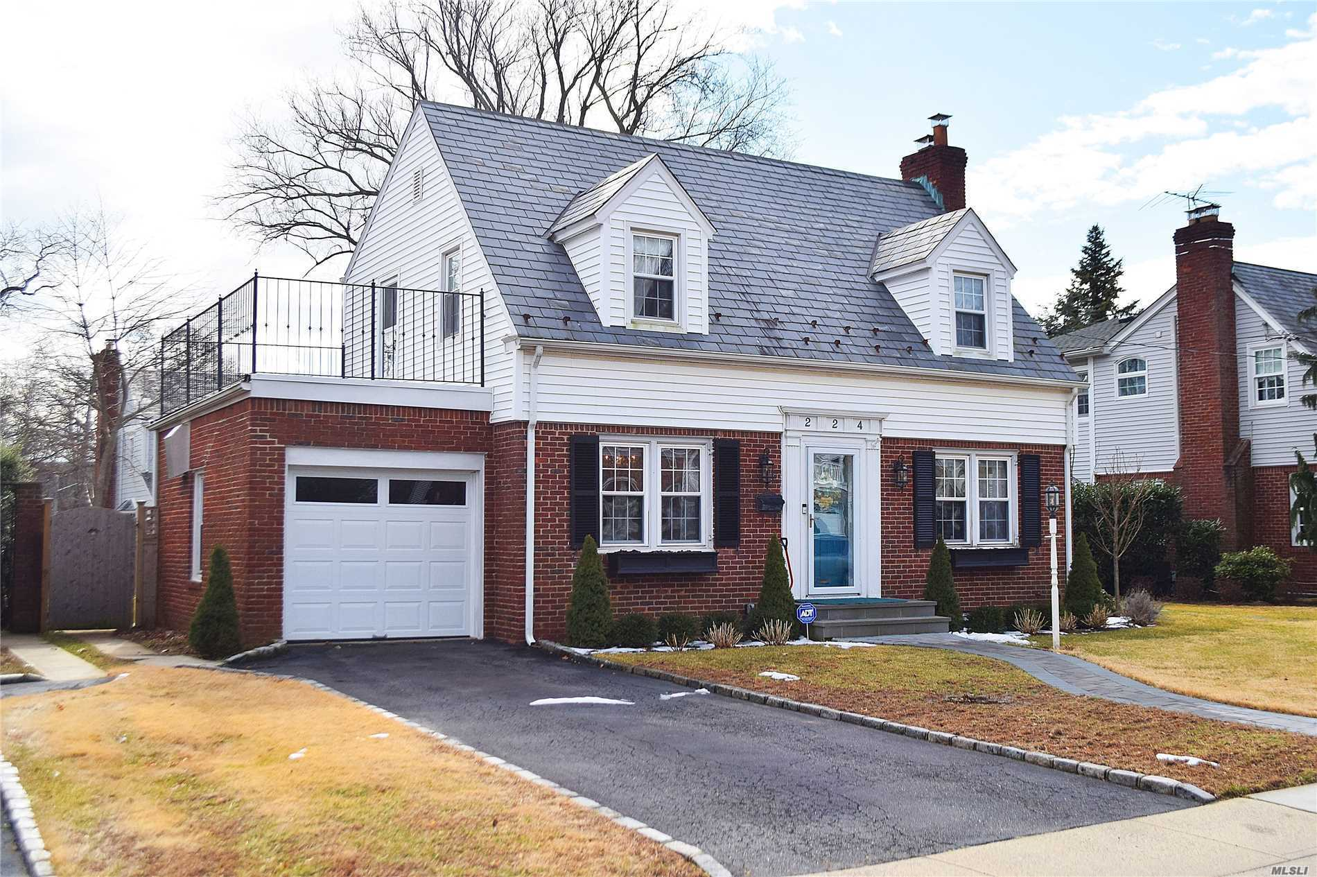 Beautiful Center Entrance Colonial Located In Malverne Park. This Home Boasts A Living Room With A Wood Burning Fireplace And A Chef's Kitchen With High End Appliances And The Den Features A Charming Cathedral Tin Ceiling. The House Has 3 Bedrooms And 2 Full Baths. Hardwood Floors. Full Basement With High Ceiling, Laundry Area. Great Size Property With Rear Paver Patio. Low Taxes!