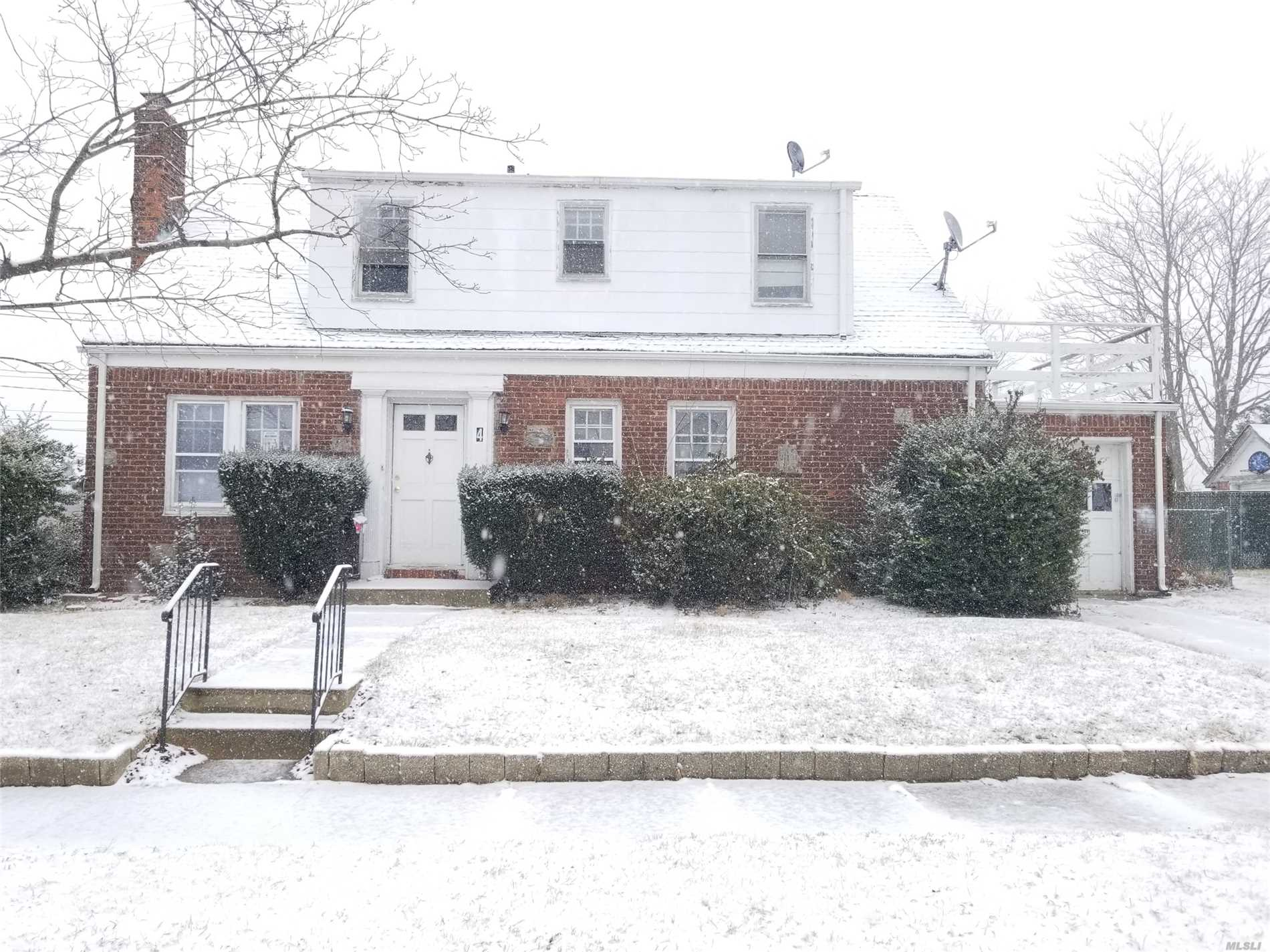 Cape With 4 Bedrooms, 2 Baths, Unfinished Basement. Livingrooms With Hardwood Floors And Fireplace. Corner Property. Close To Shopping, Transportation And Major Roadways