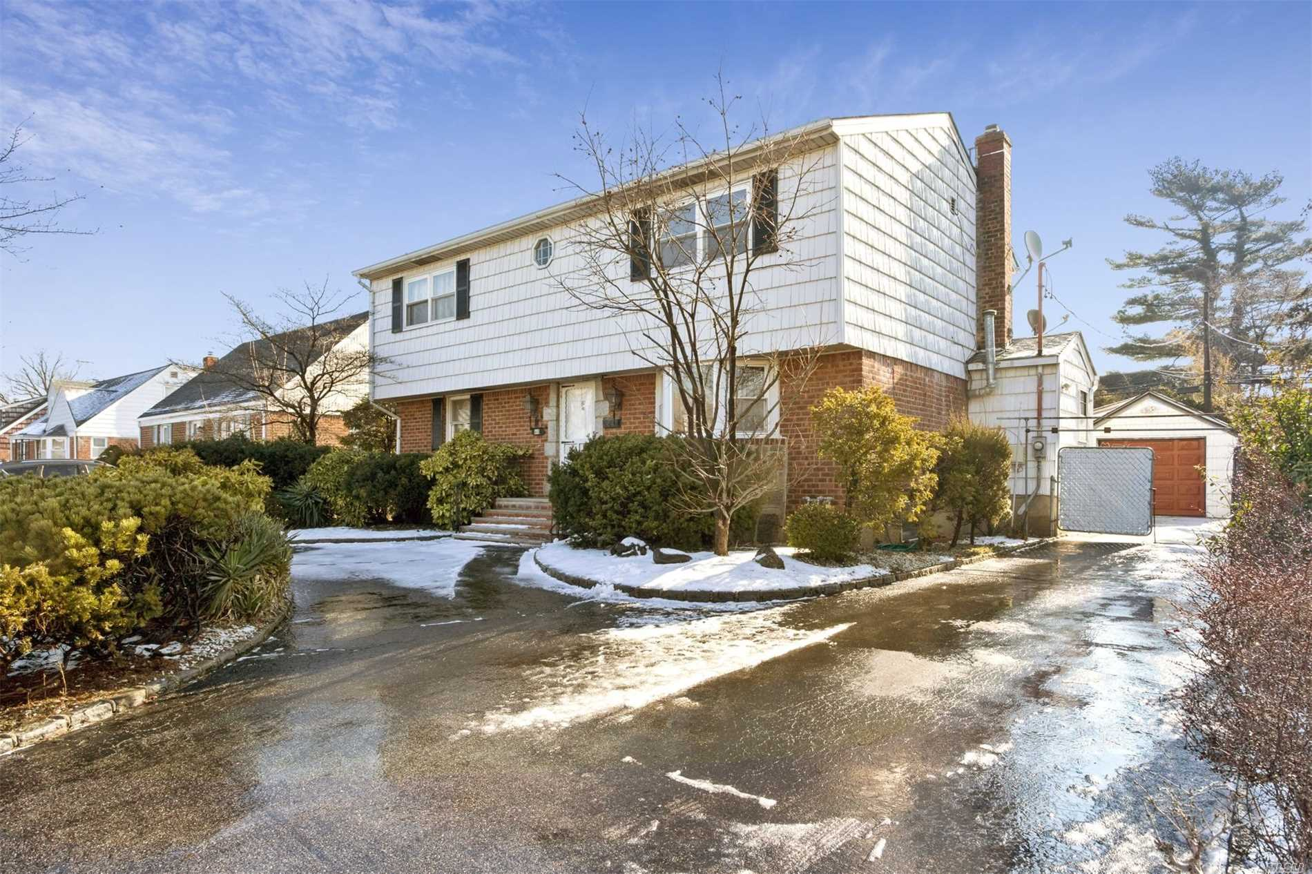 This 2040 Sf Expanded Cape Cod Boasts All Large Rooms, Living Room,  Large Eat-In-Kitchen,  Den/Bedroom, A Huge Master Bedroom With A Dressing Room, Large Bedrooms, Two Updated Full Baths, New Hardwood Floors, Newly Painted, Updated Gas Boiler And Water Heater, Central Air, 60X100 Private Fenced Yard, 1.5 Car Detached Garage Wide Circular Driveway, Gas Heat , Close To Shopping Centers, Public Transportation, Parks And Parkways. Must See!!!