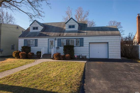 Cute & Clean As Can Be!! 4 Bedroom Cape Cod In Move In Condition W/ Super L-O-W Taxes!