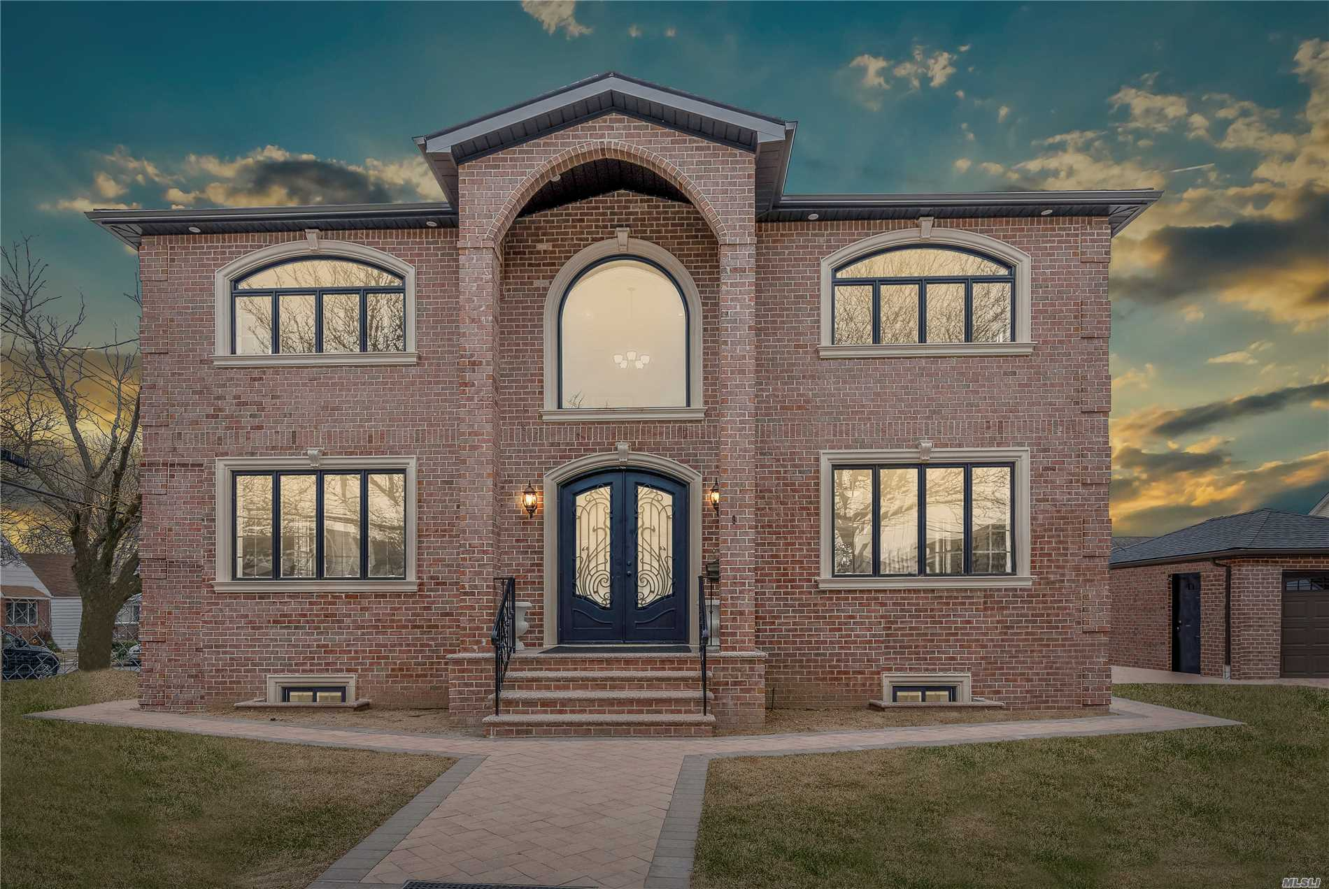 Elegant Newly Constructed 5 Bedroom, 4.5 Bathroom Brick Colonial On A 60X100 Lot W/Unparalleled Craftmanship & Design! Open & Inviting 3000 Sqft. Floor Plan W/Great Flow For Entertaining. Features Include Gas Fireplace, Crown Moulding, Hardwood Floors, Gourmet Kitchen W/ Cherry Cabinets, Quartz Countertops, & Custom Windows That Provide Plenty Of Natural Lighting Throughout. Master Suite With 2 Wic, Oversized Bedrooms, Custom Baths, & Spacious Basement W/ High Ceilings, Ose. 1 Car Garage. Sd#26