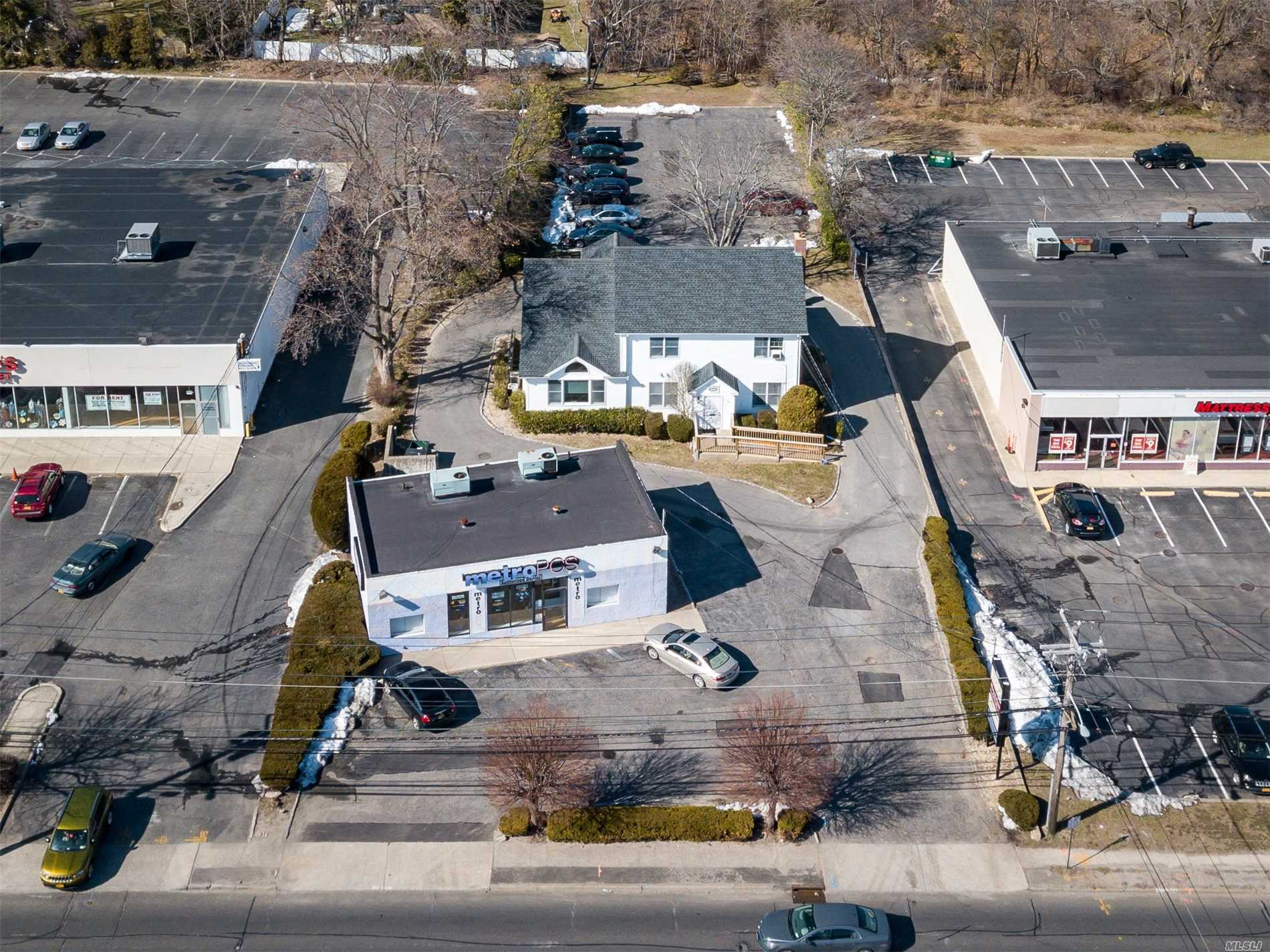 Located On The North Side Of Jericho Tpke. Two Separate Structures On 1 Lot With 30-Car Parking Spots. Single Story Bldg Located In The Front Of Property W/5-Parking Spaces. Rear Bldg Is A 2-Story 4, 000Sf Office Building With Multiple Private And Professional Suites. Rear Building Has A Full Finished Basement And Walk-Up Attic. Rear Parking For 25-Cars.