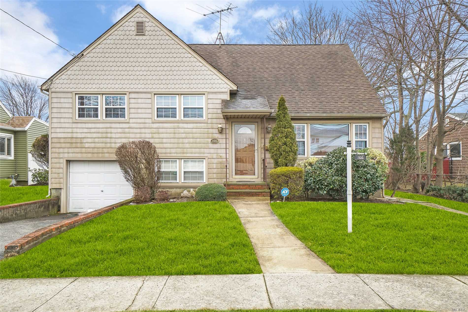 Make This Your Dream Home! Lovely Split Located On A Unique Large Property. Features 3 Bdrms, Full Bath, Lr, Fdr, Sunroom, Hardwood Floors, One Car Garage And Pvt. Driveway. Plenty Of Storage! Convenient To Lirr, Local Transportation And Beaches! Loads Of Potential!